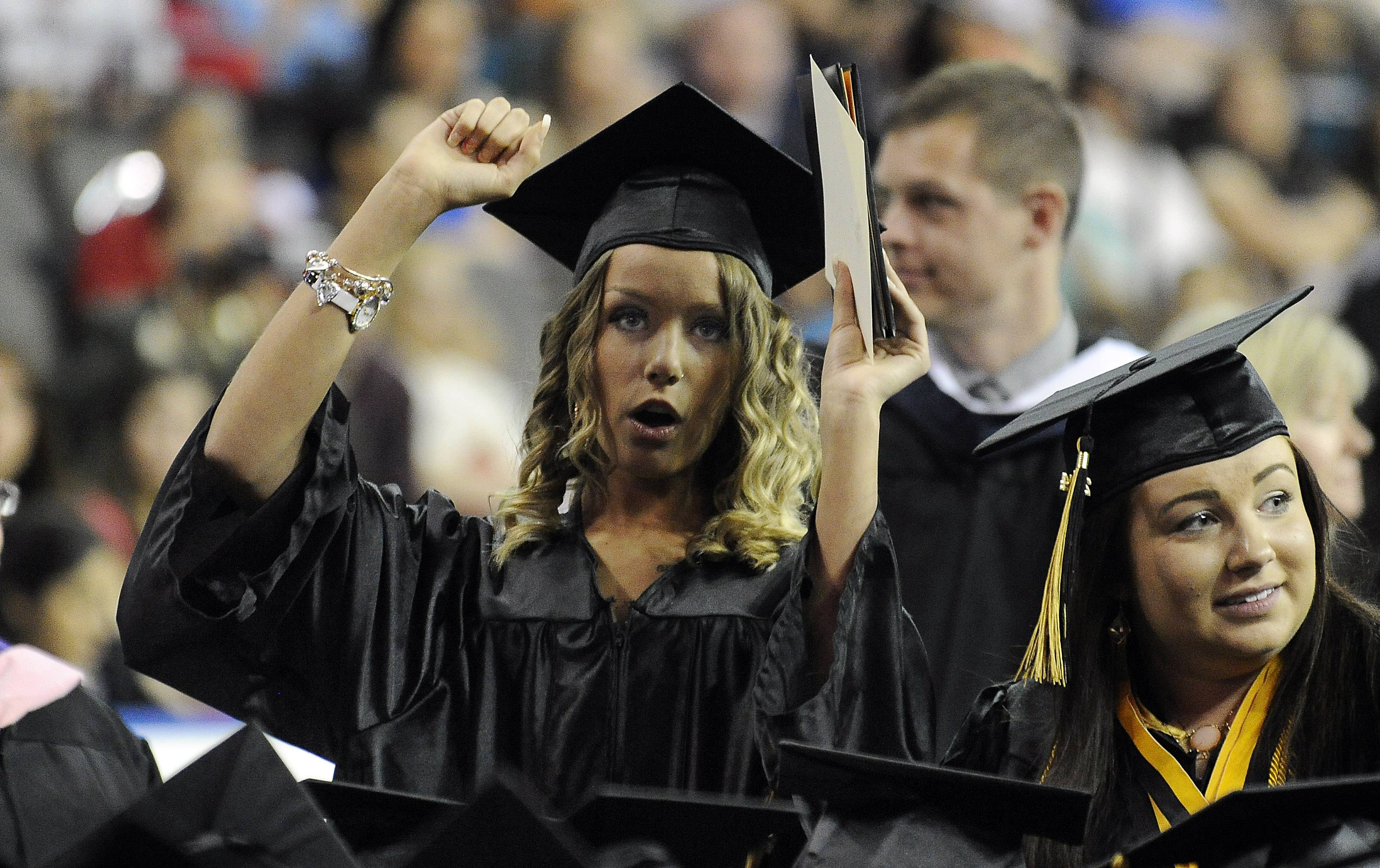 Kelli Morris, 18, of Streamwood starts to feel the excitement of being a graduate as the 35th commencement exercises comes to a close at  the Sears Centre in Hoffman Estates on Saturday.