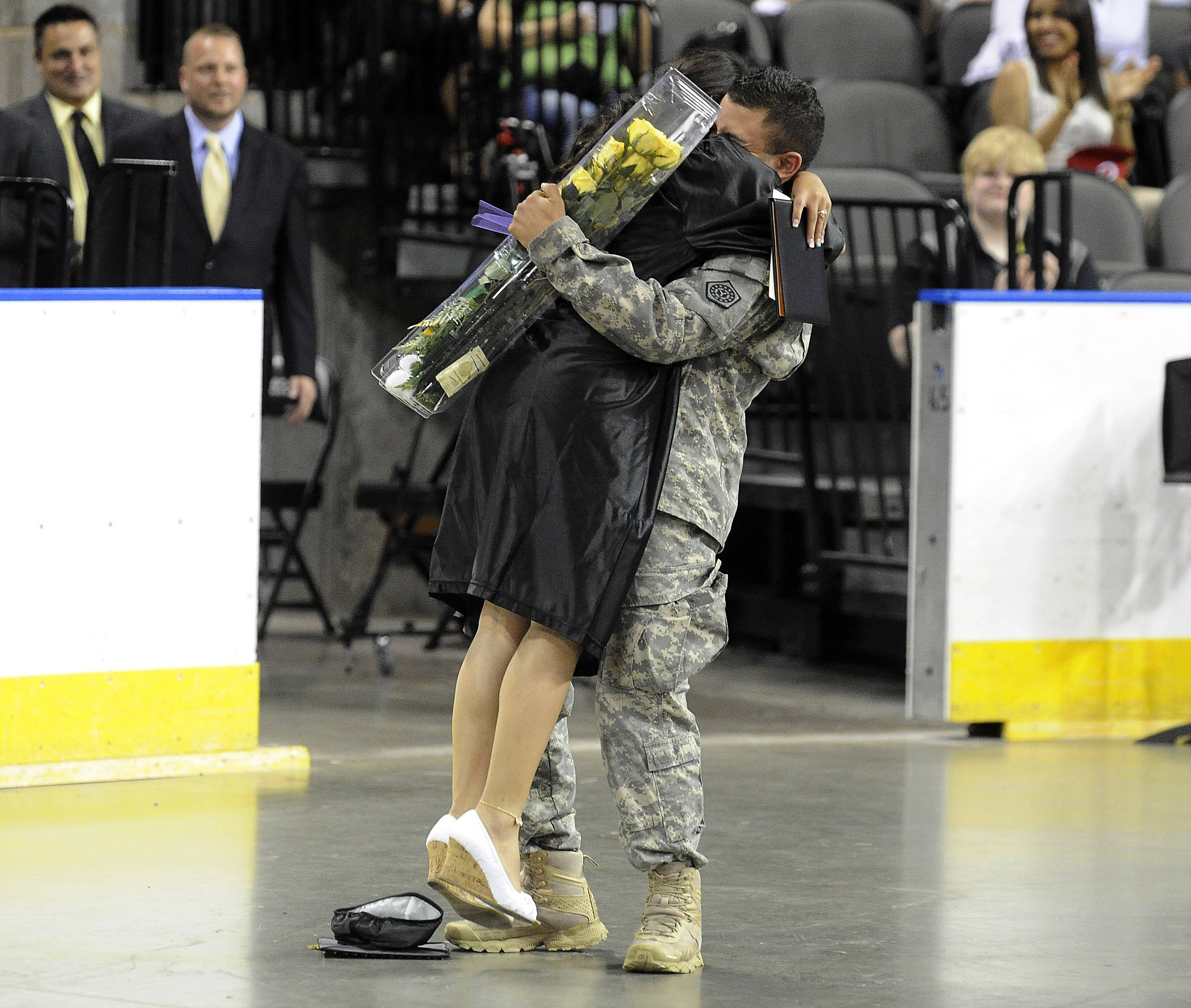 Robert Leal, 22, who is in the Army surprises his cousin Myranda Rico, 17, of Streamwood as the 35th commencement exercises at  the Sears Centre in Hoffman Estates on Saturday. It has been 8 months since they have seen each other.