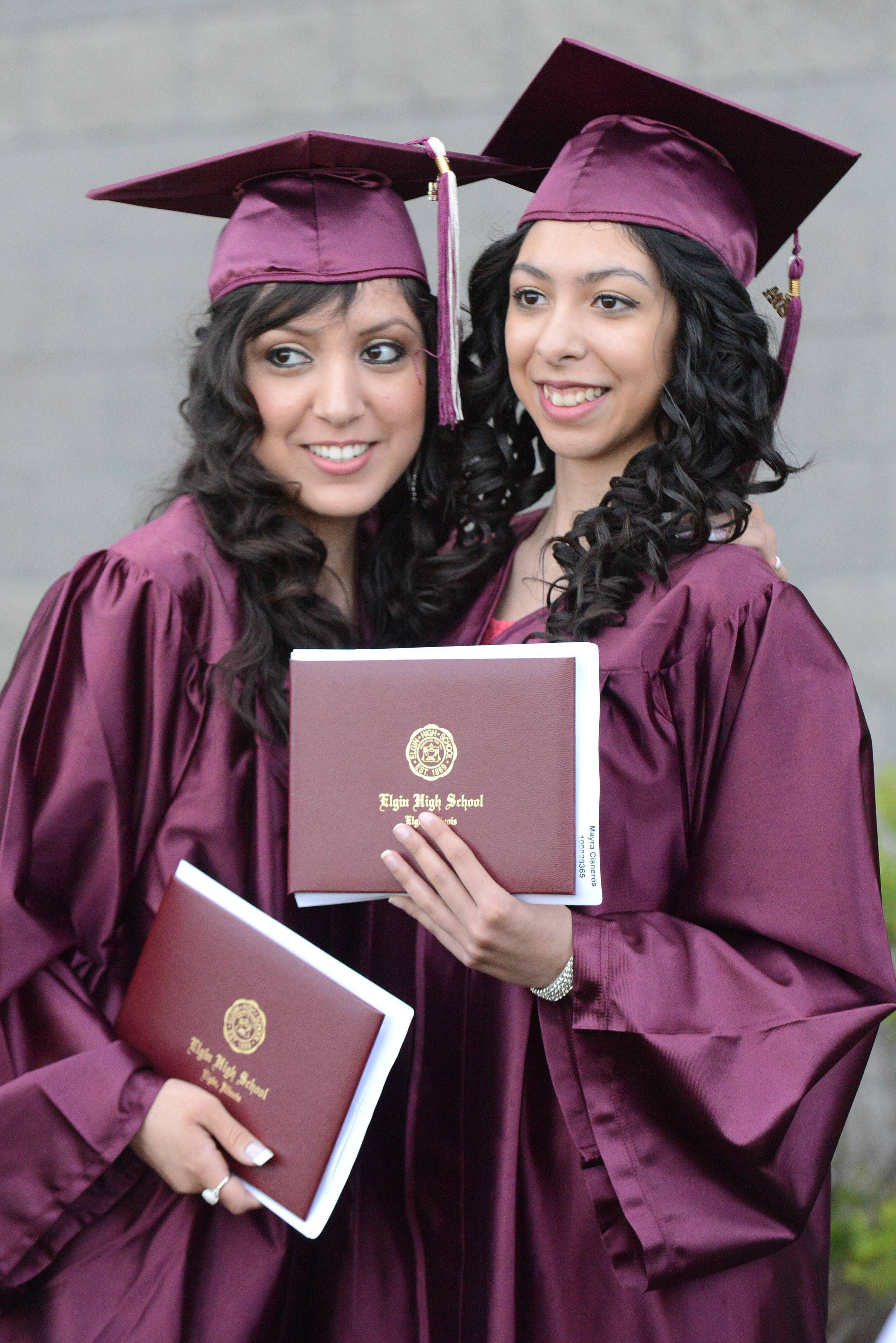 Elgin High School graduates Adriana Martinez, left, and Mayra Cisneros, both of Elgin, pose with their diplomas after their commencement ceremony at the Sears Centre in Hoffman Estates on Saturday, May 24.