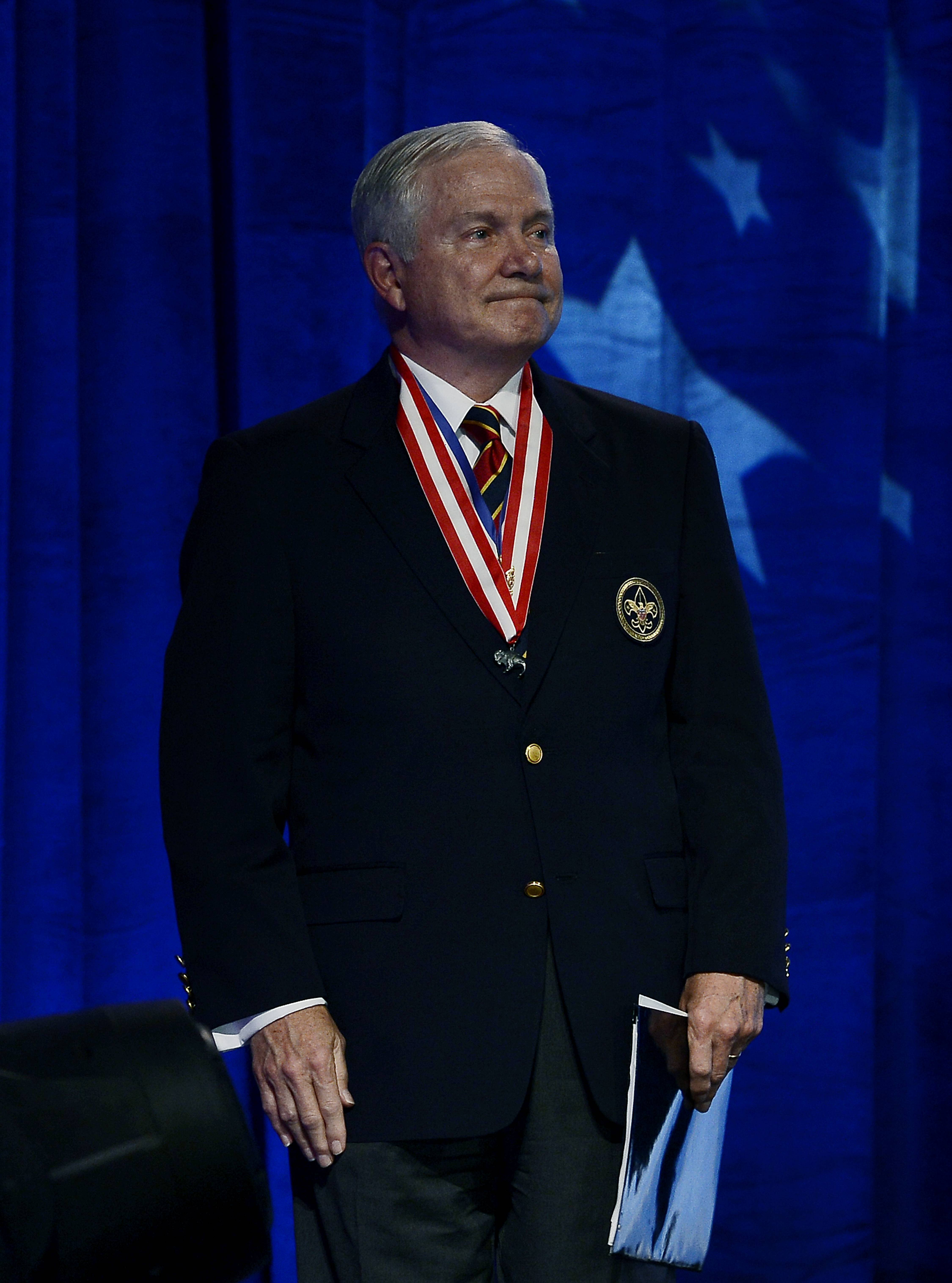 Former Defense Secretary Robert Gates looks at the standing ovation by the audience after addressing the Boy Scouts of America's annual meeting on Friday, May 23, in Nashville, Tenn., after being selected as the organization's new president. Gates is taking over one of the nation's largest youth organizations as it fights a membership decline and debates its policy toward gays.