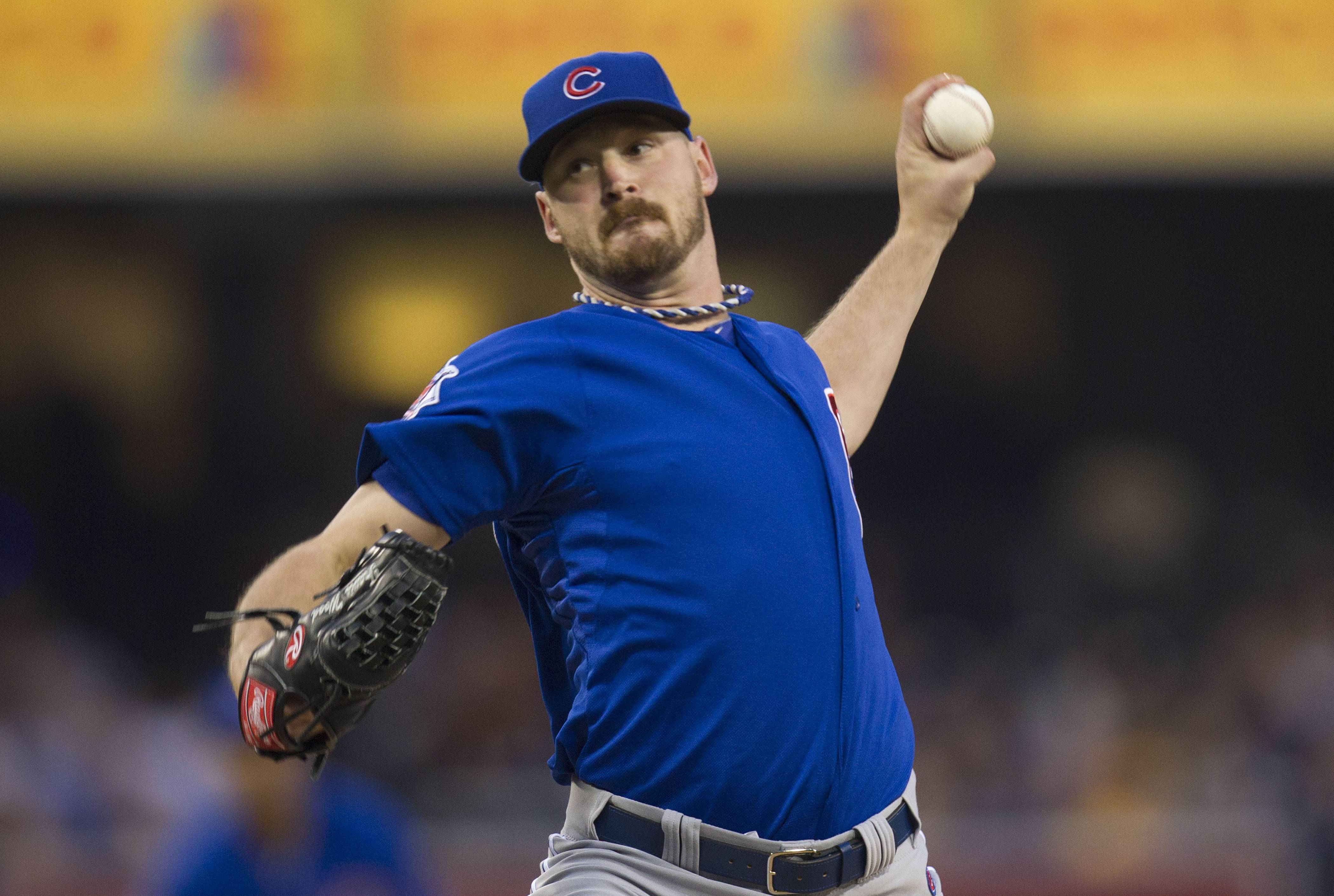 Cubs left-hander Travis Wood came within five outs of pitching his first career shutout before allowing Carlos Quentin's pinch-hit, two-run home run, and the Cubs held on to beat the San Diego Padres 3-2 Saturday night. Wood (5-4) hit an RBI single and Luis Valbuena homered for the Cubs, who bounced back from an 11-1 loss Friday night.