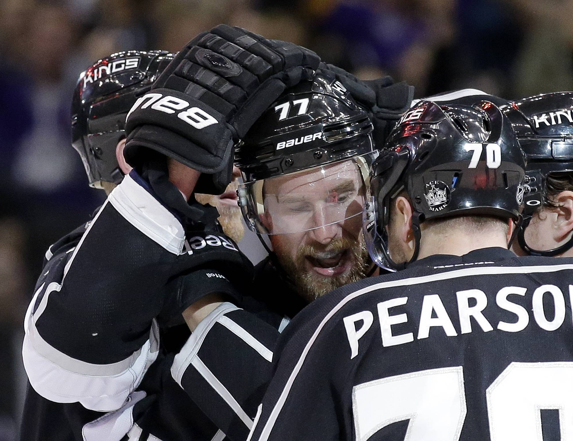 Los Angeles Kings center Jeff Carter (77) celebrates his goal against the Chicago Blackhawks with Tanner Pearson during the second period of Game 3 of the Western Conference finals of the NHL hockey Stanley Cup playoffs in Los Angeles, Saturday, May 24, 2014.