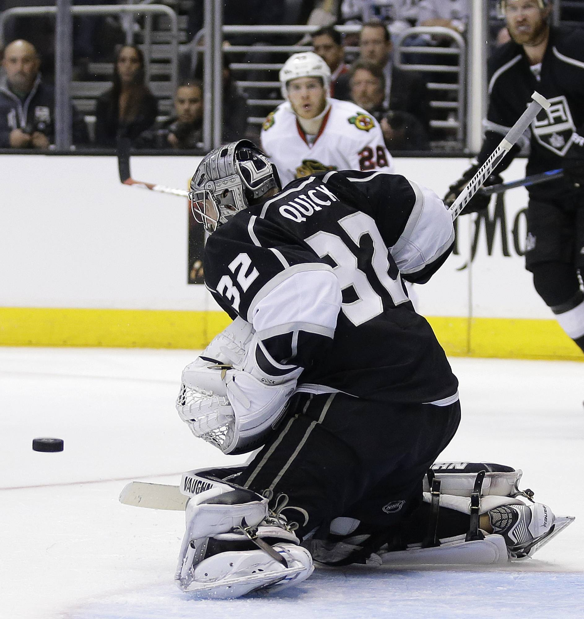 Los Angeles Kings goalie Jonathan Quick (32) blocks a shot by Chicago Blackhawks right wing Ben Smith during the third period of Game 3 of the Western Conference finals of the NHL hockey Stanley Cup playoffs in Los Angeles, Saturday, May 24, 2014.