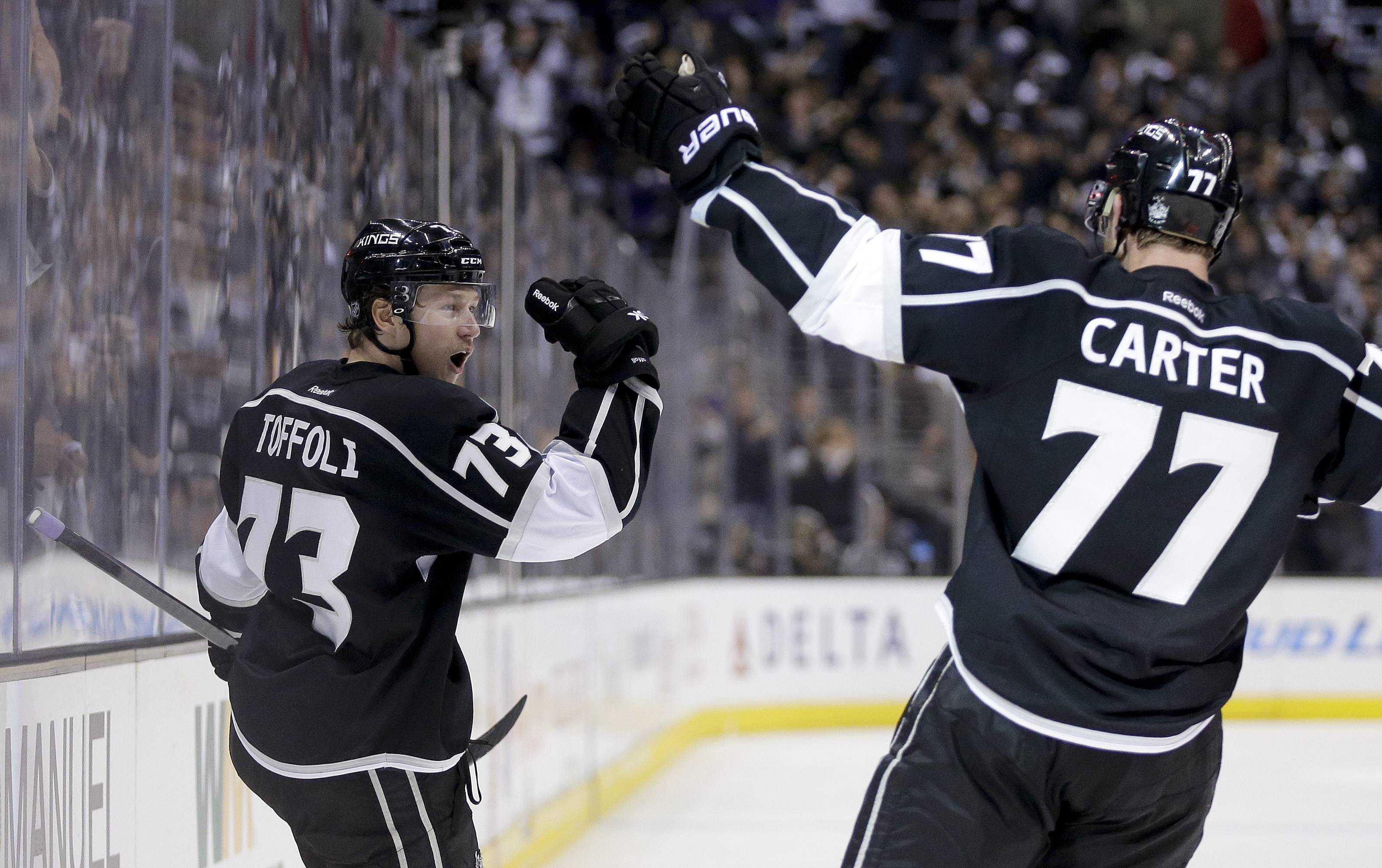 Los Angeles Kings center Tyler Toffoli, left, celebrates his goal with teammate Jeff Carter against the Chicago Blackhawks during the second period of Game 3 of the Western Conference finals of the NHL hockey Stanley Cup playoffs in Los Angeles, Saturday, May 24, 2014.