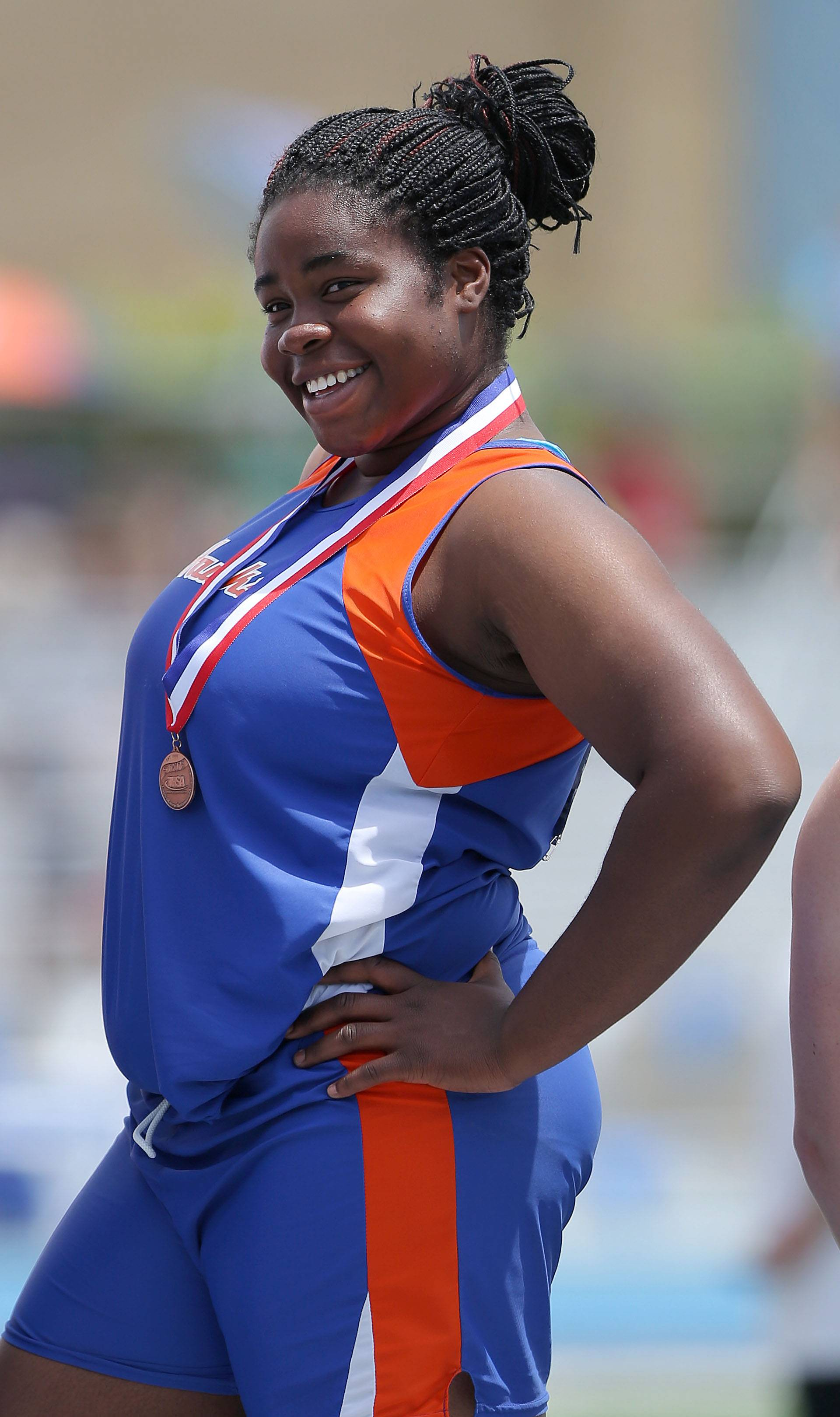 Hoffman Estates' Banke Oginni poses with her shot put medal during the girls track and field state finals at Eastern Illinois University in Charleston on Saturday.