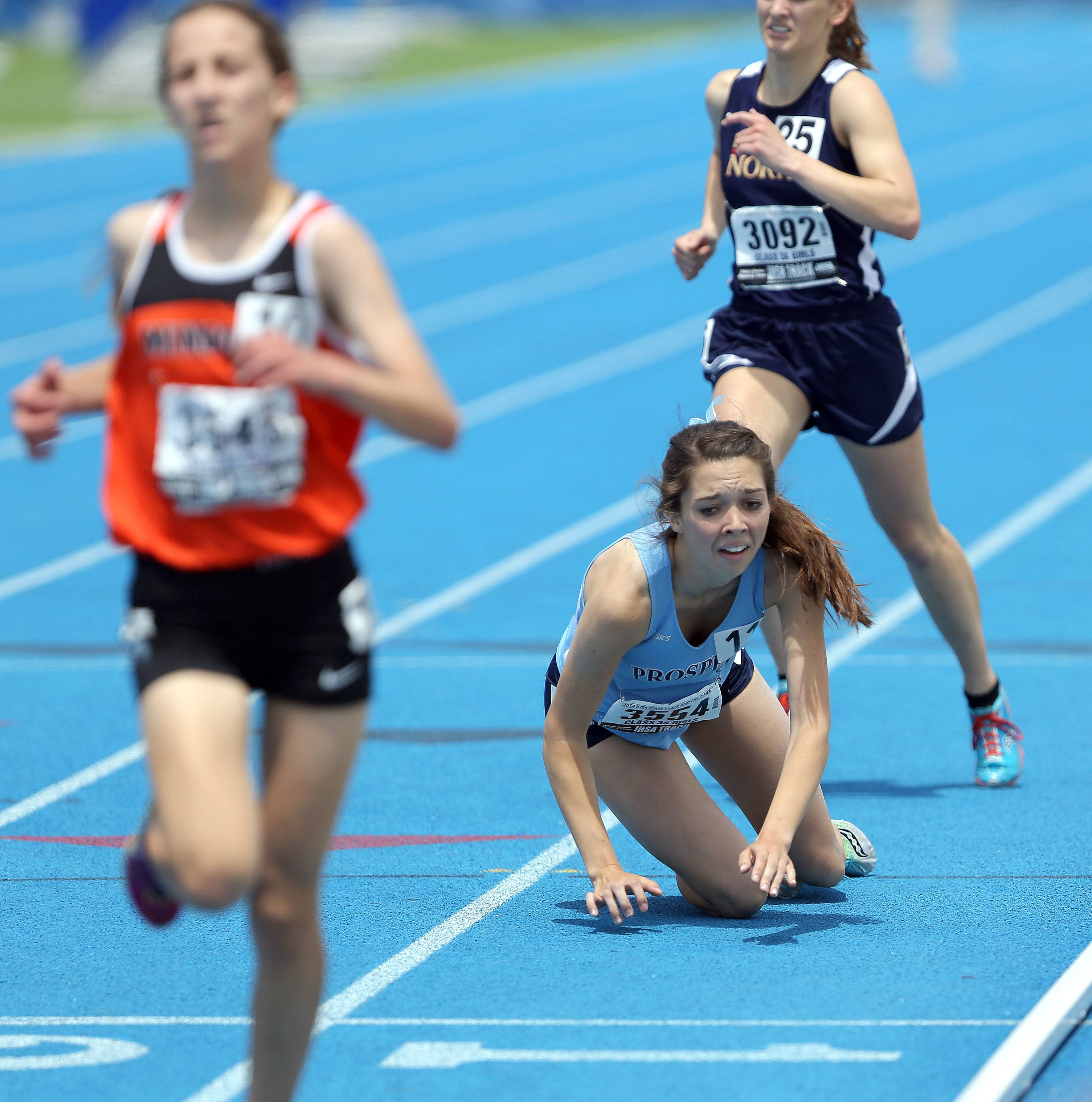 Prospects Christina Santiago stumbles at the finish line in the Class 3A 3,200-meter run during the girls track and field state finals at Eastern Illinois University in Charleston on Saturday.