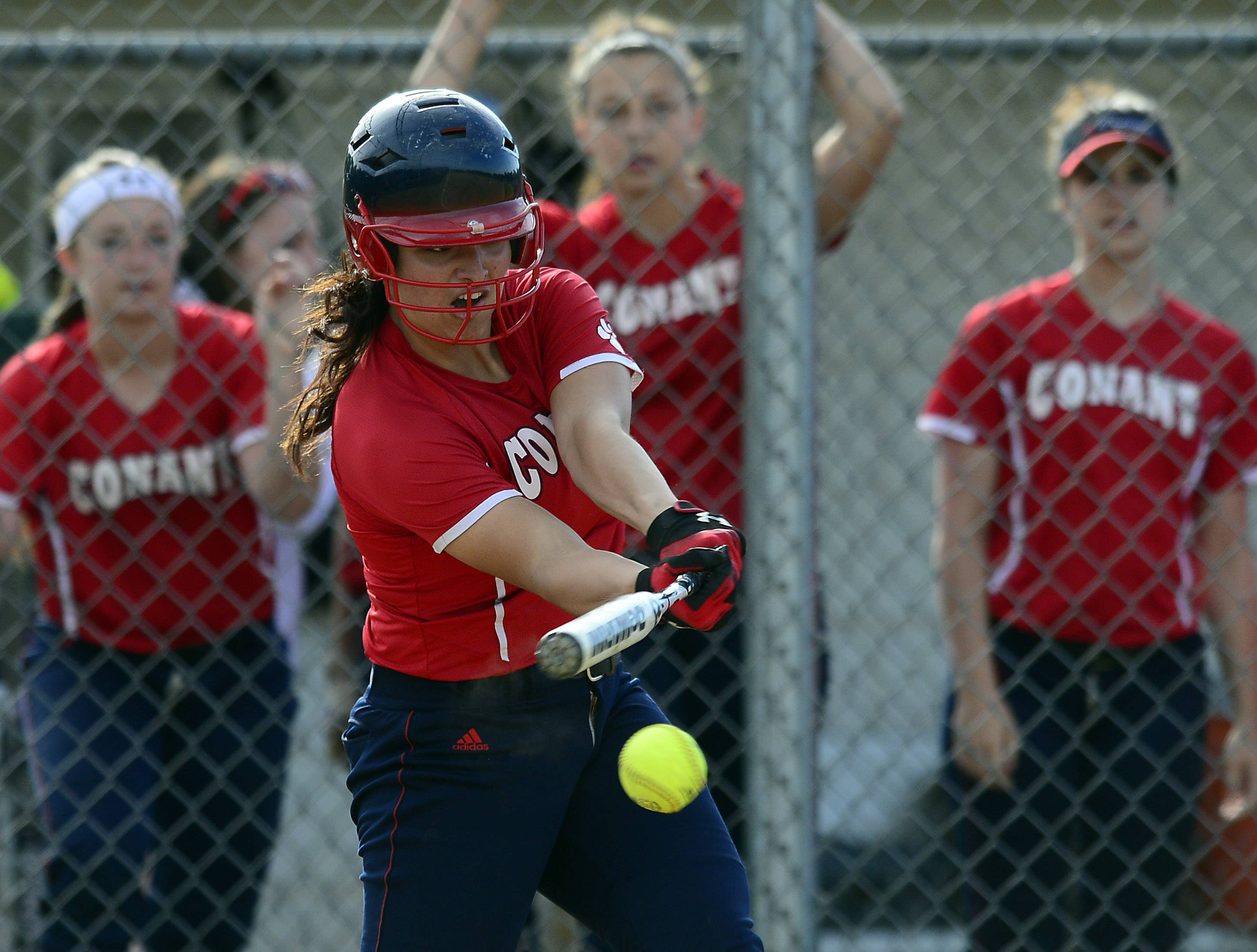 Conant and Alissa Wachal, here swinging against Buffalo Grove in the MSL title game, open up their postseason with a Tuesday regional semifinal at Hoffman Estates.