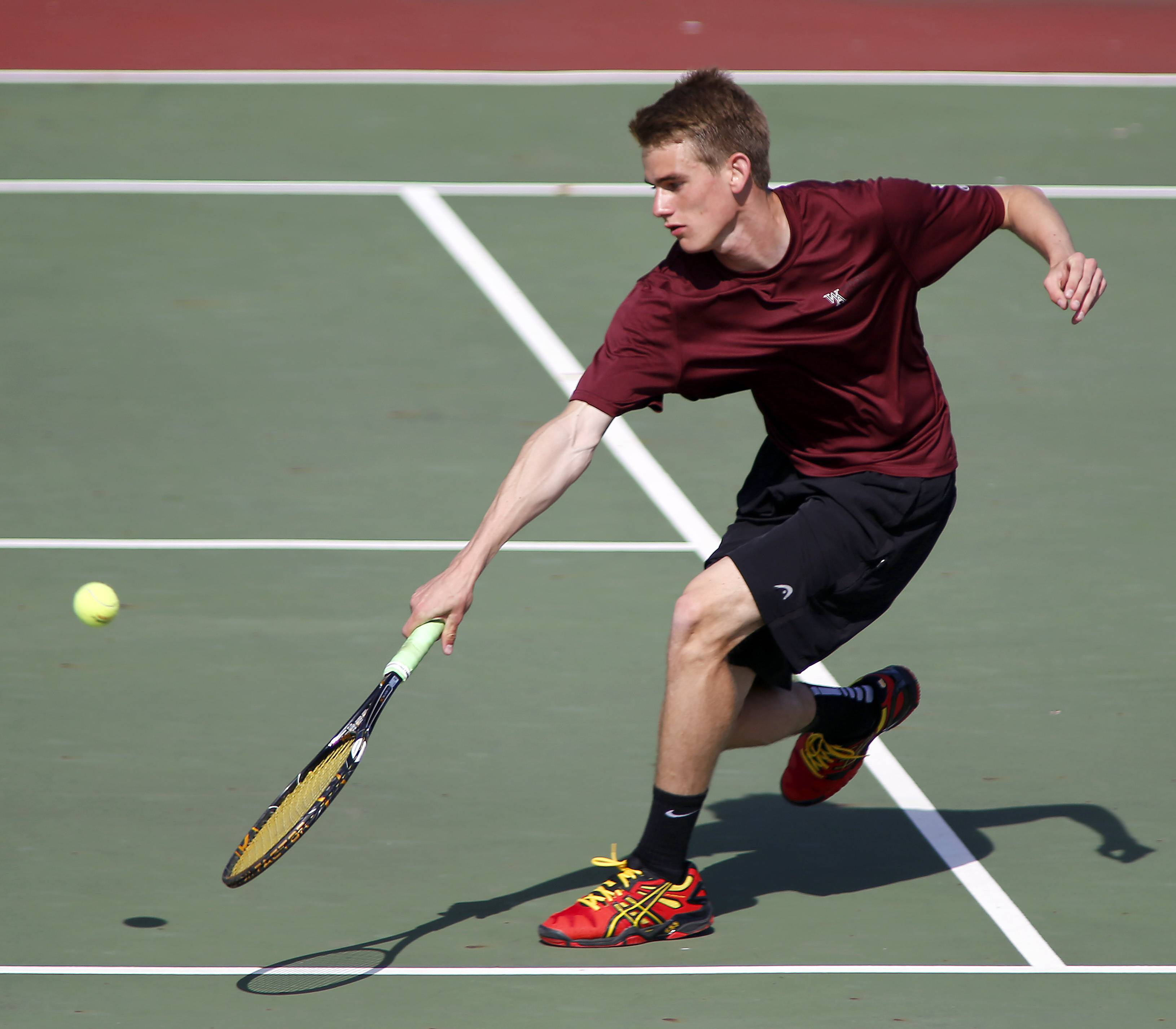 Wheaton Academy's Chris Jones returns a shot from St. Charles East's Jasper Koenen during the St. Charles East boys tennis sectional Saturday in St. Charles.