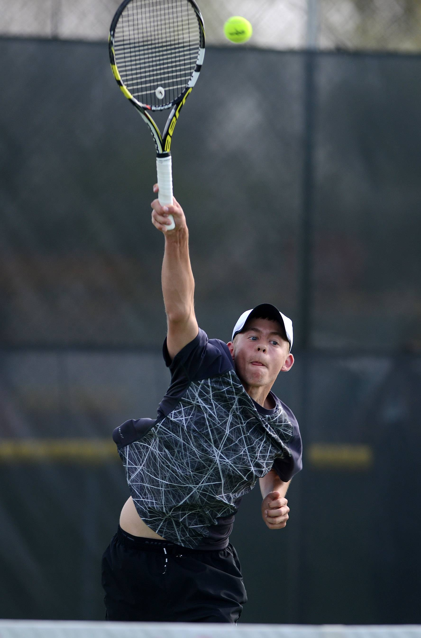 Aaron Amburgey, above, and his partner Grant Spellman won the doubles sectional championship Saturday at St. Charles East, and their win keyed the team sectional title for the North Stars.