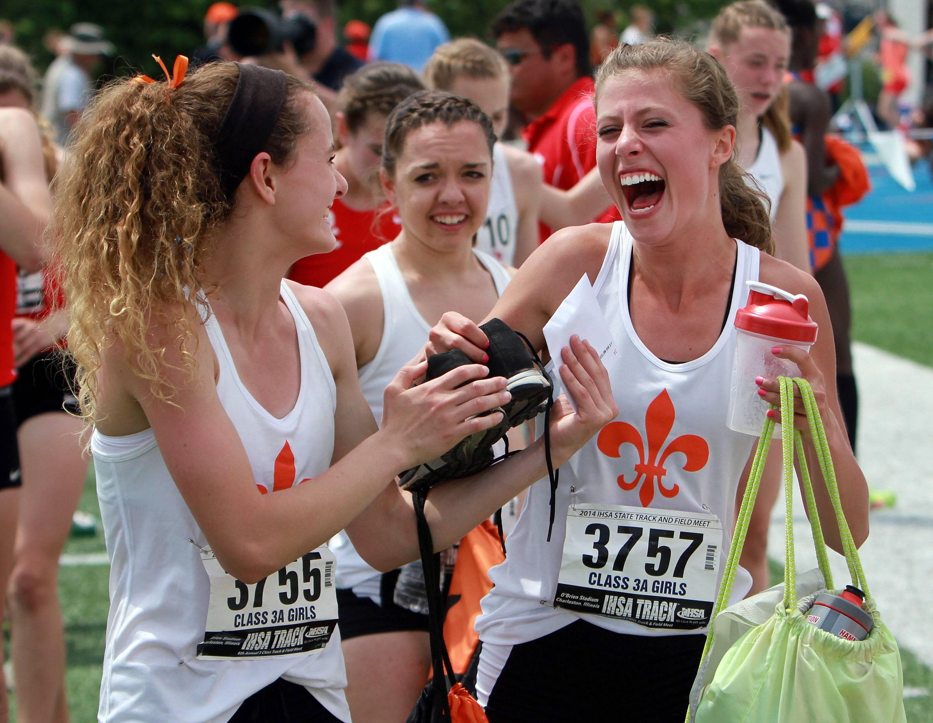 St. Charles East runners celebrate after their win in the 4x800-meter relay during the girls track and field state finals at Eastern Illinois University in Charleston Saturday.