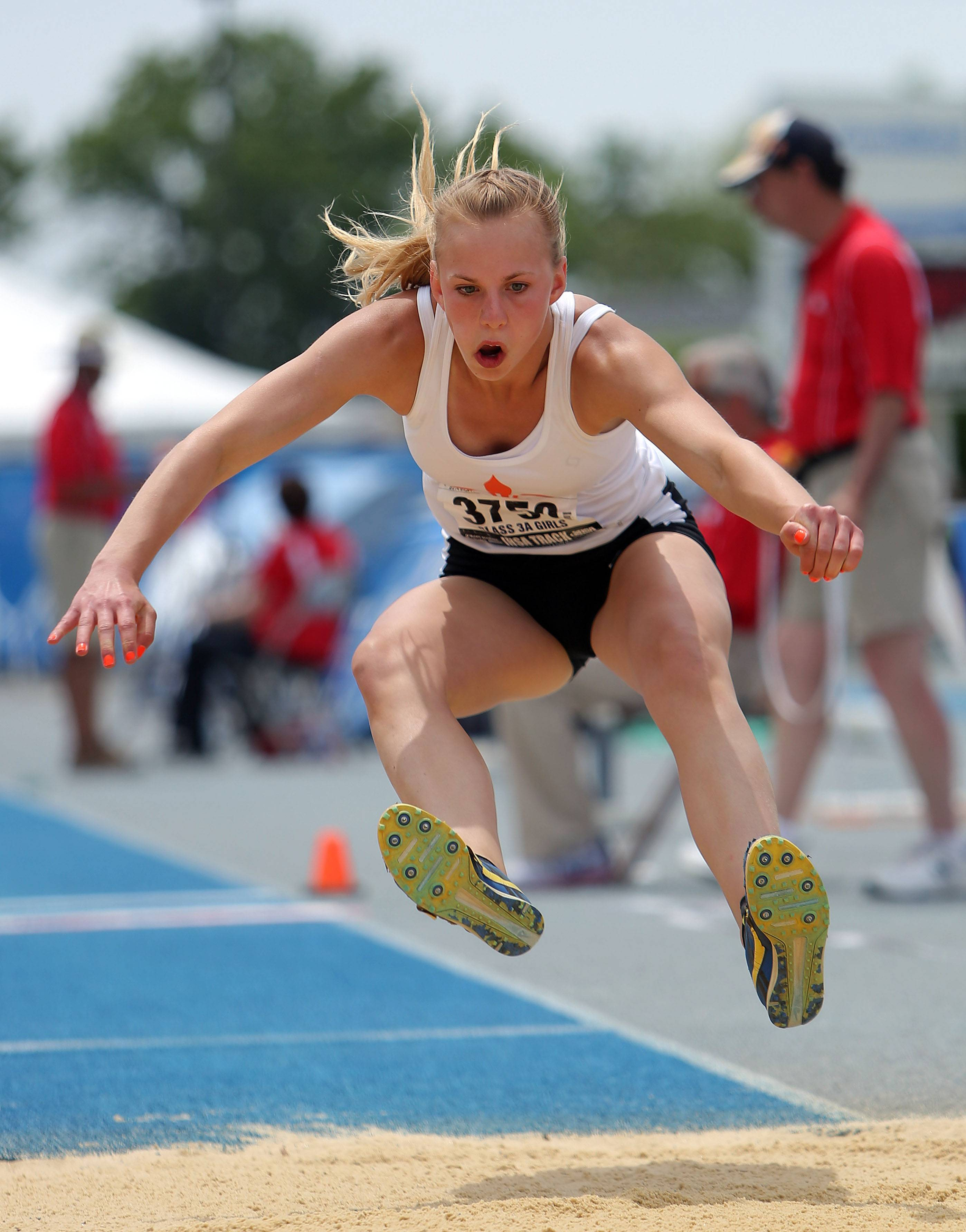 St. Charles East's Allison Chmelik competes in the class 3A triple jump during the girls track and field state finals at Eastern Illinois University in Charleston Saturday.