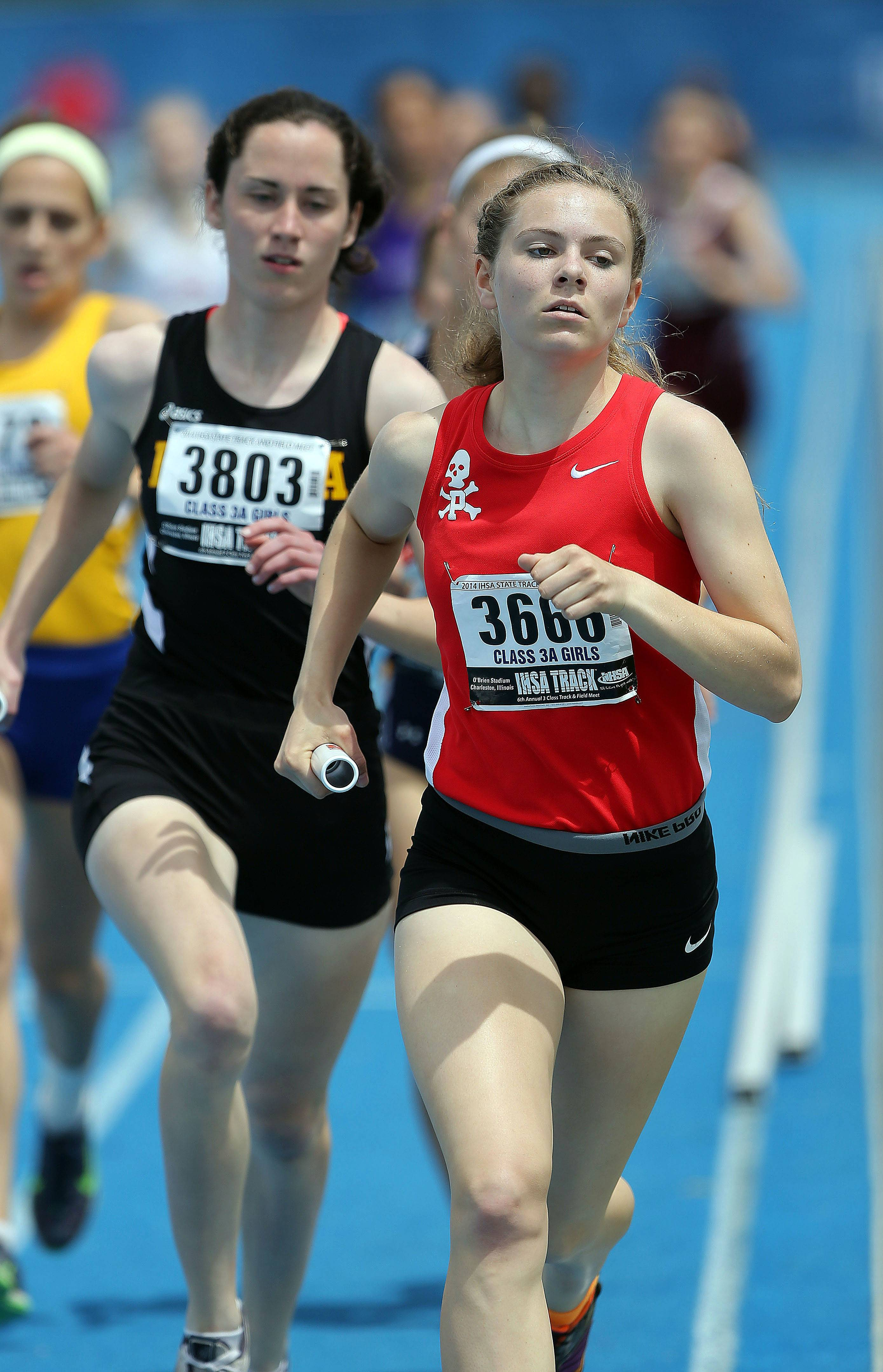 Palatine's Kara Burton competes in the class 3A 4x800-meter relay during the girls track and field state finals at Eastern Illinois University in Charleston Saturday.