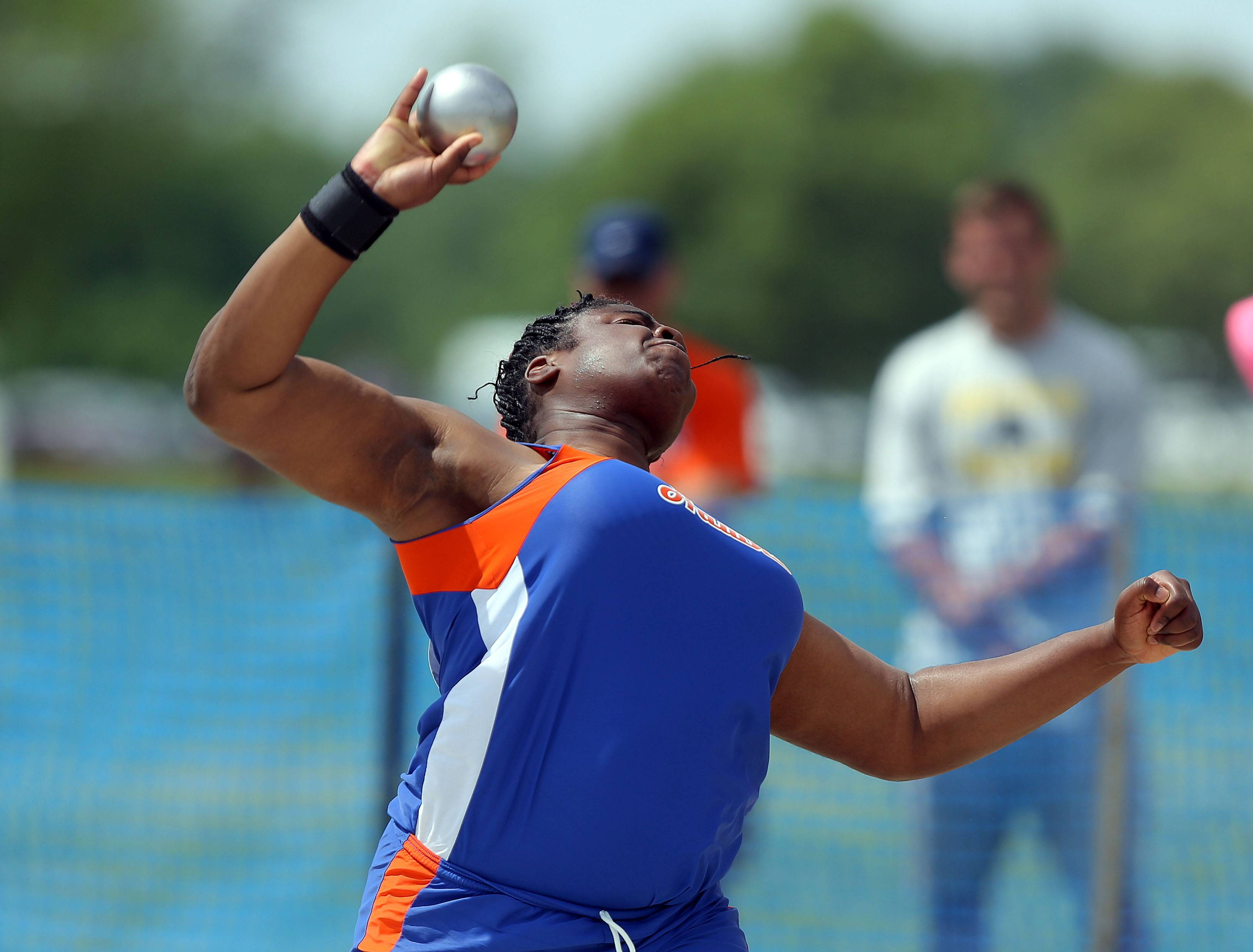 Hoffman Estates' Banke Oginni competes in the class 3A shot put during the girls track and field state finals at Eastern Illinois University in Charleston Saturday.