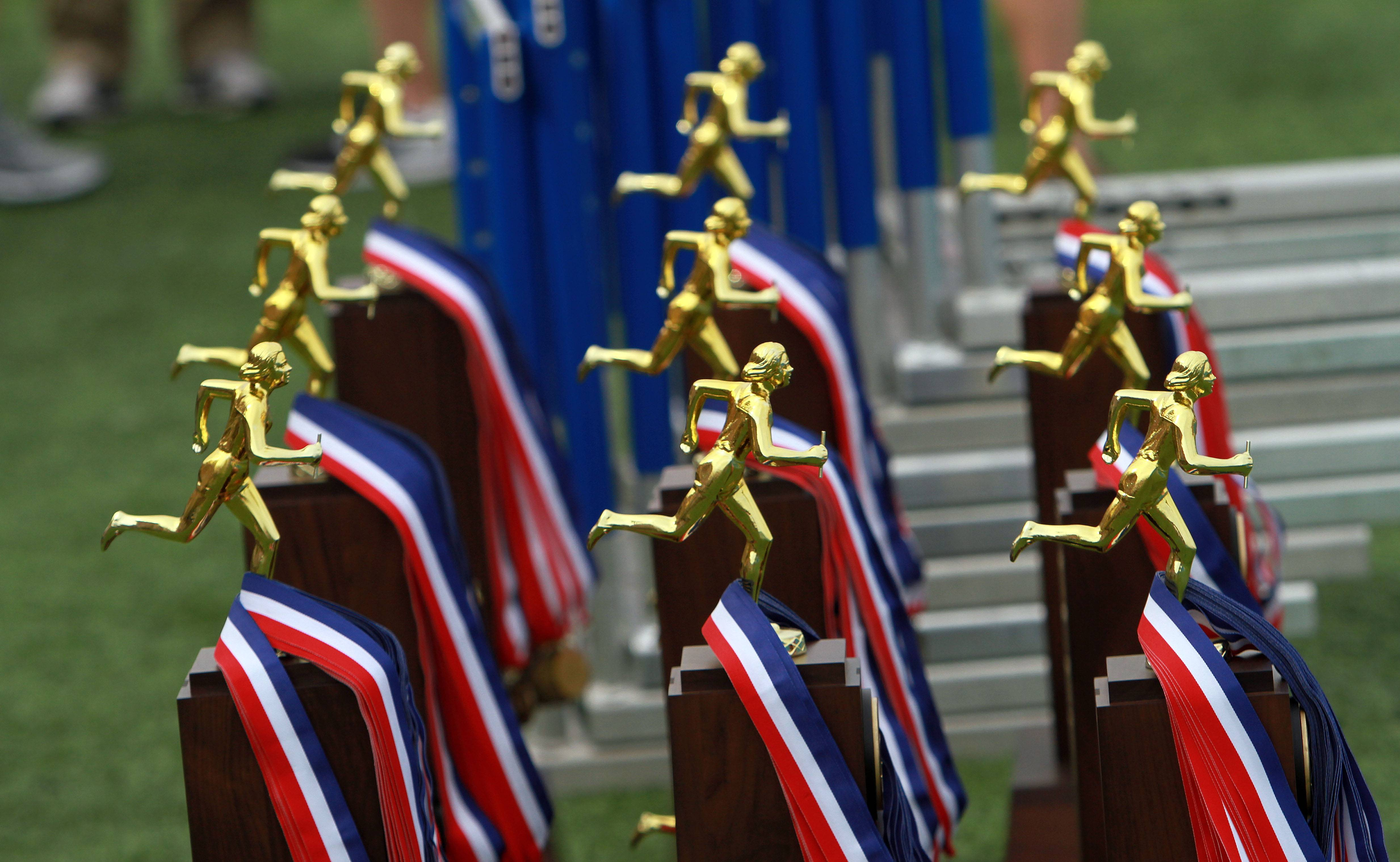 Trophies await their teams during the girls track and field state finals at Eastern Illinois University in Charleston Saturday.