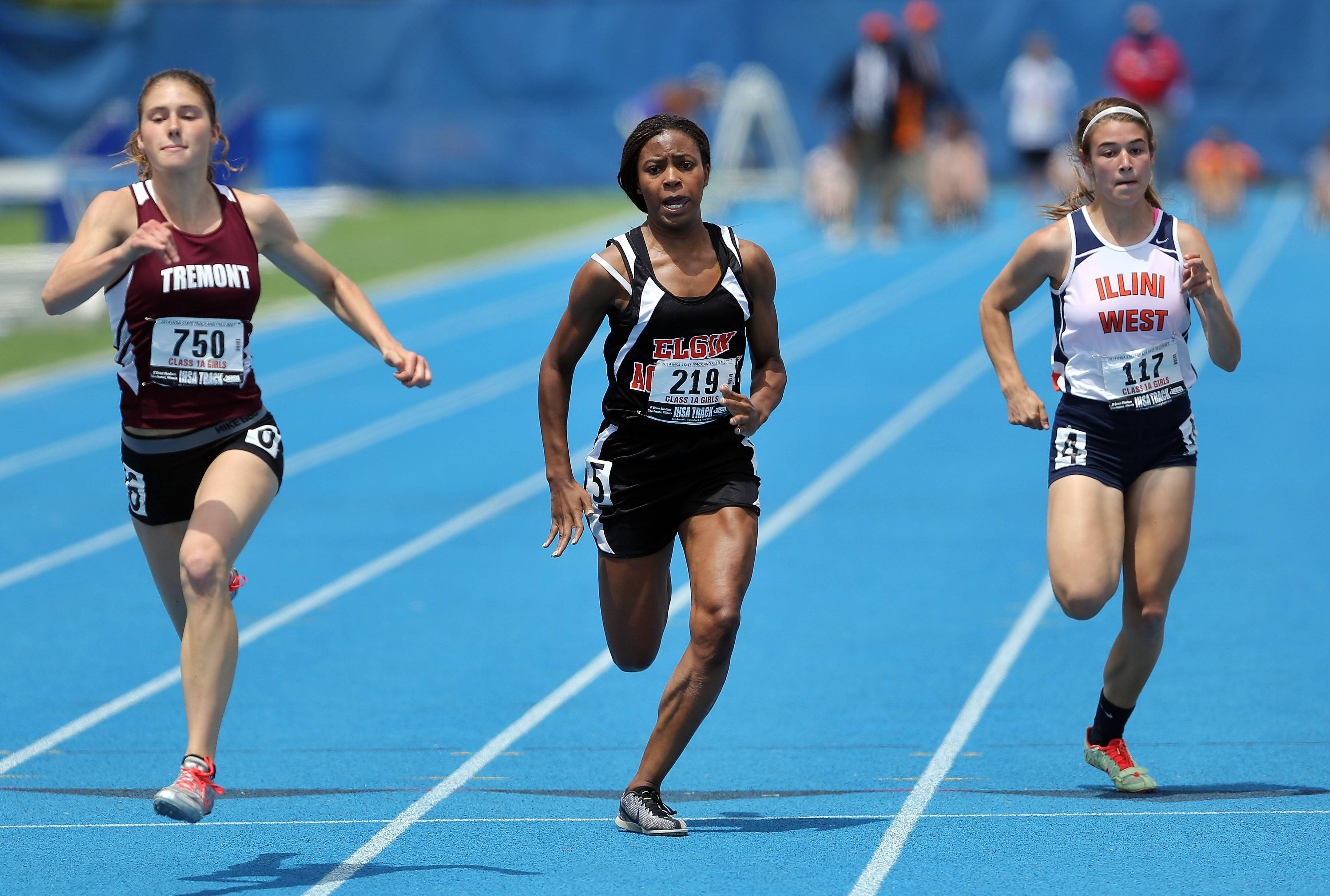 Elgin Academy's Kaitlyn Pearson, center, powers to the finish in the 100-meter dash during the girls track and field state finals at Eastern Illinois University in Charleston Saturday.
