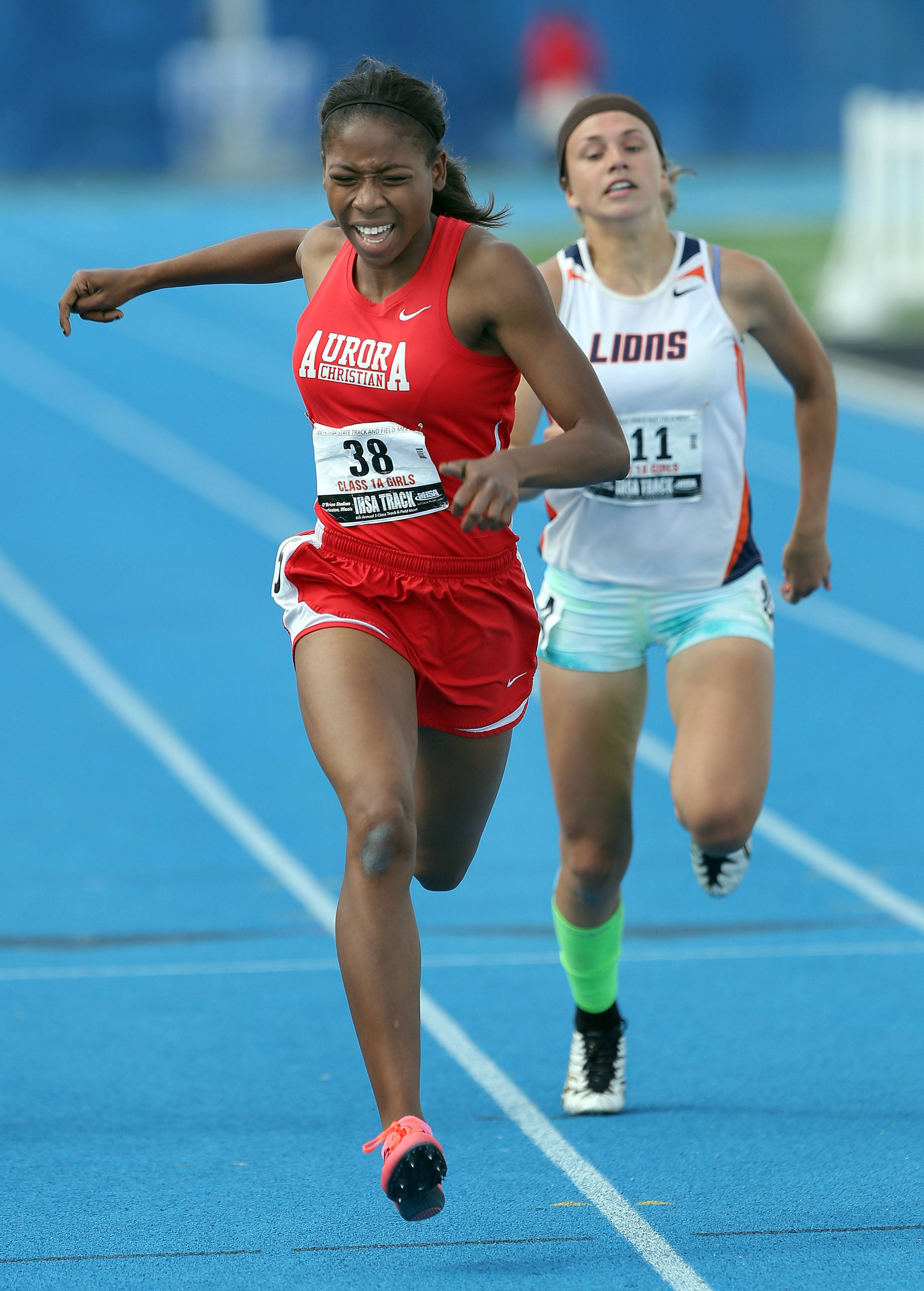 Aurora Christian's Natasha Brown wins the class 1A 200-meter dash during the girls track and field state finals at Eastern Illinois University in Charleston Saturday.