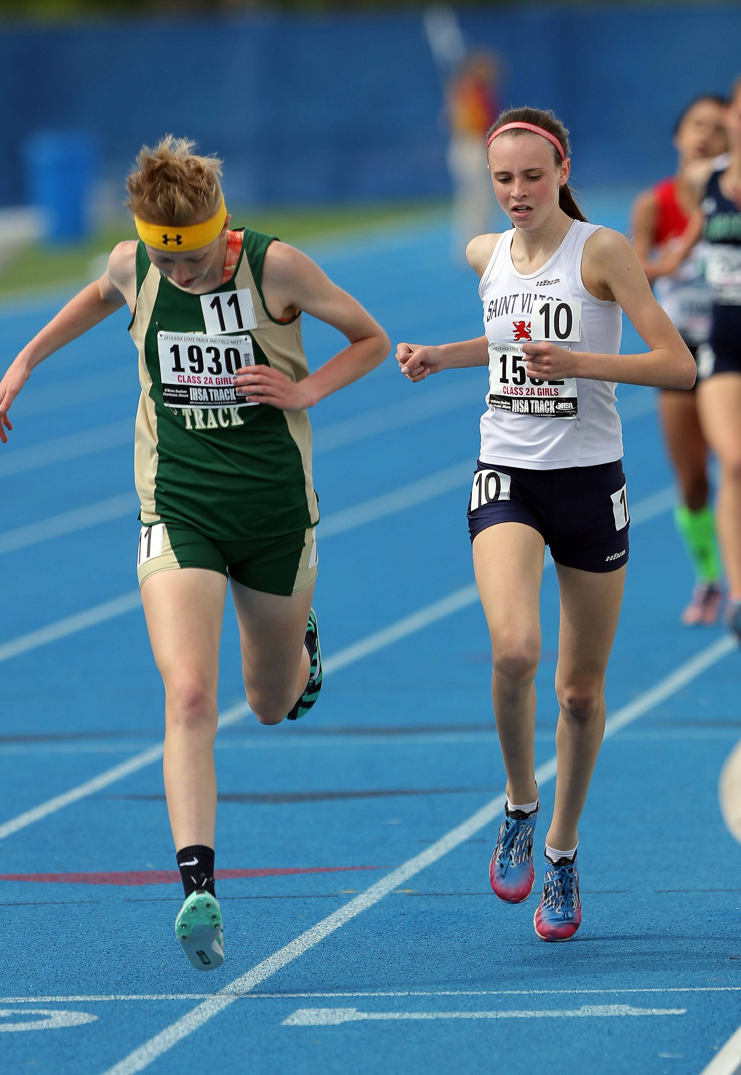 St. Viator's Meghan Carroll, right, is edged out at the finish line by Mattoon's Megan Shaffer in the class 2A 1600-meter run during the girls track and field state finals at Eastern Illinois University in Charleston Saturday.