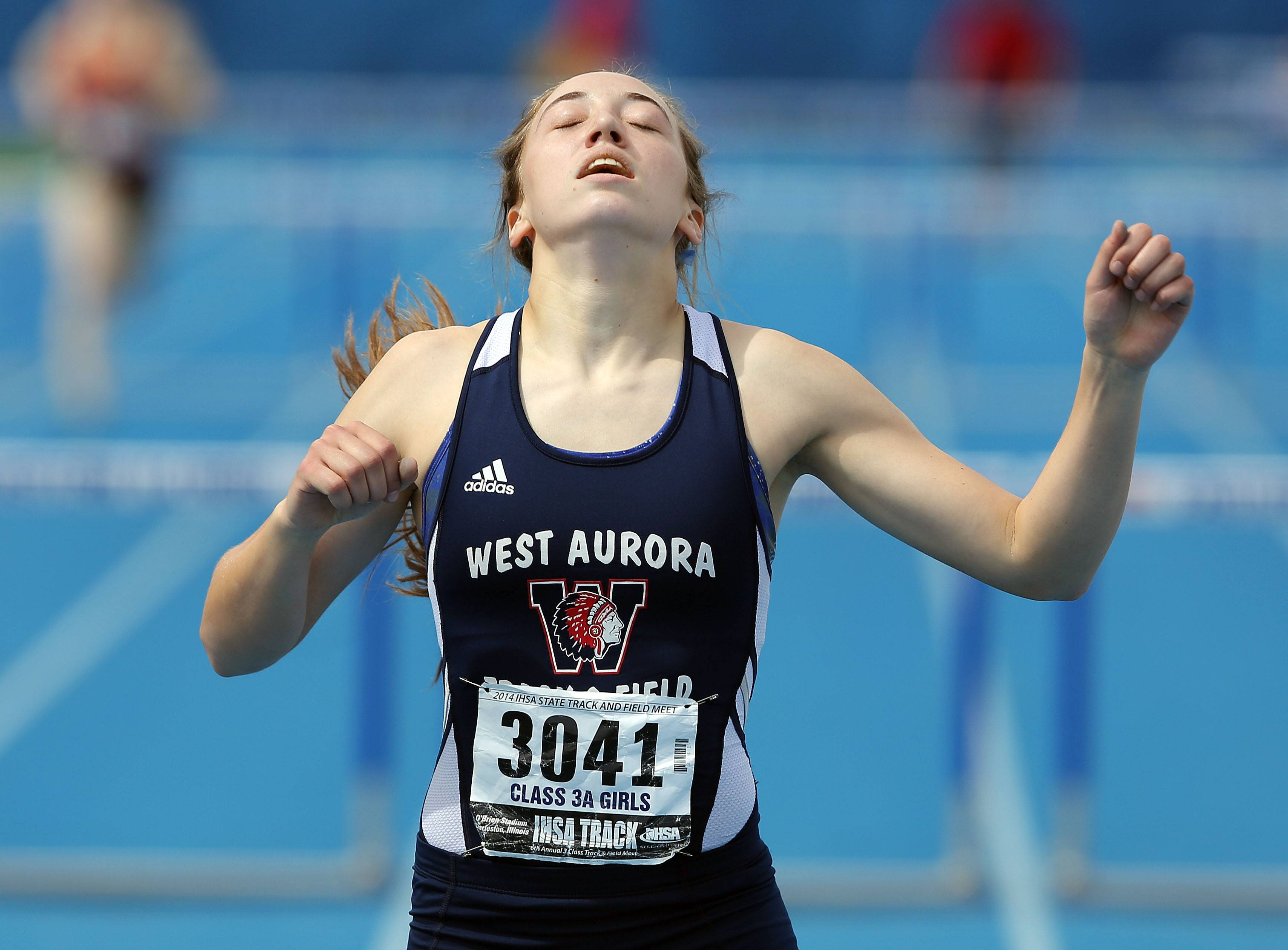 West Aurora's Emma Spagnola reacts after winning the class 3A 300-meter low hurdles during the girls track and field state finals at Eastern Illinois University in Charleston Saturday.