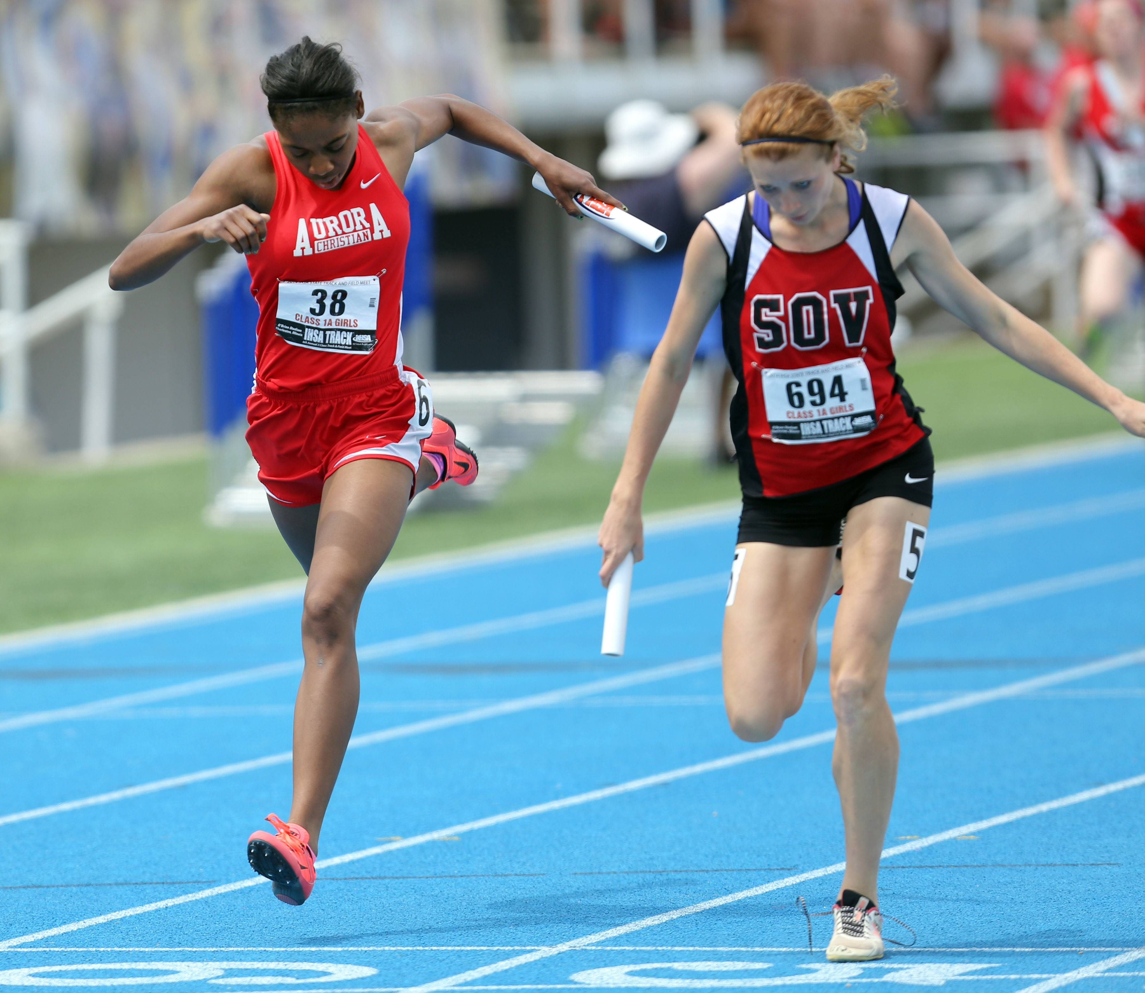 Aurora Christian's Natasha Brown, left, is edged out at the finish lone by Sullivan's Amanda McClain in the class 1A 4x200-meter relay during the girls track and field state finals at Eastern Illinois University in Charleston Saturday.