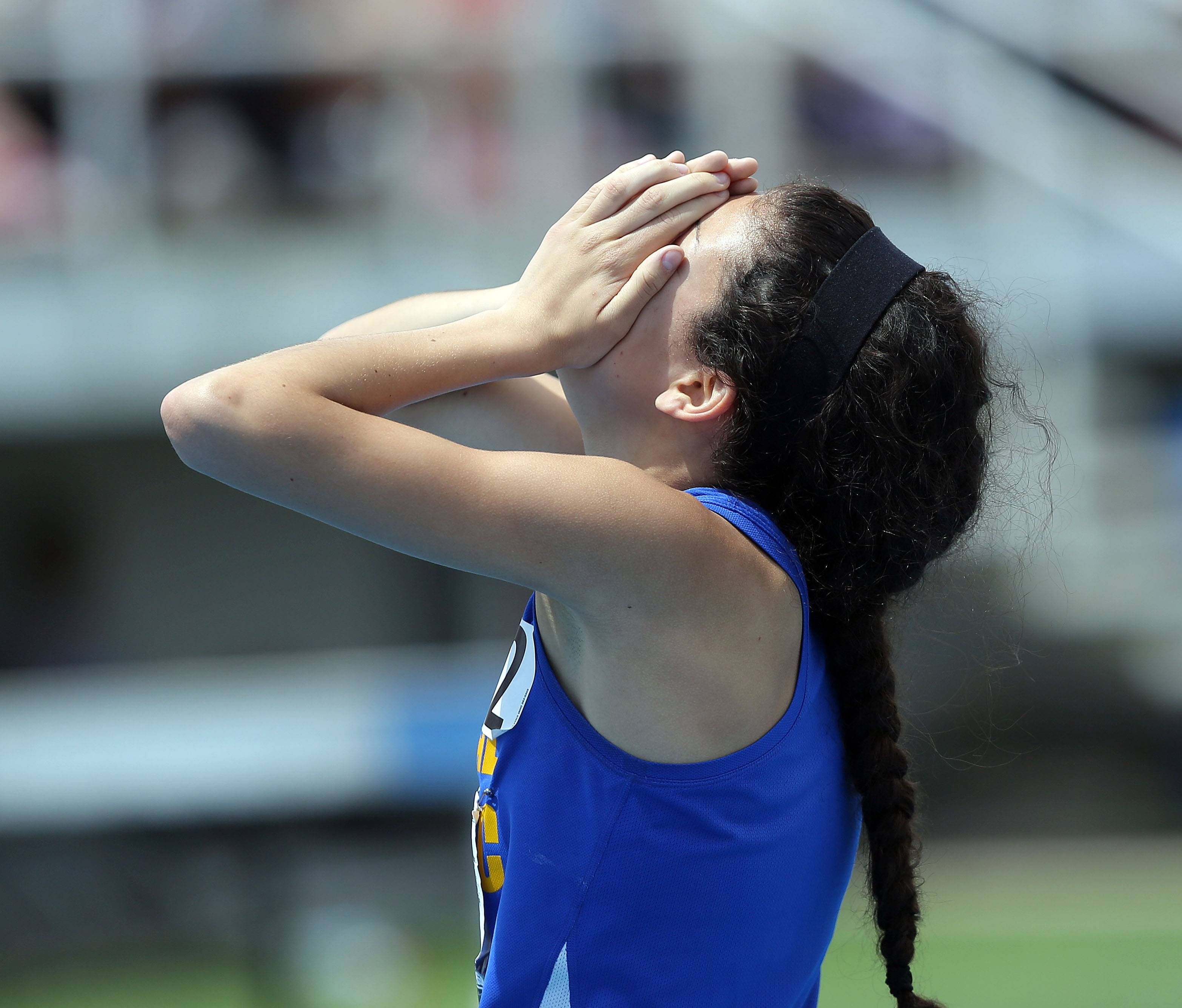 Aurora Central Catholic's Karina Liz reacts after winning the class 2A 800-meter run during the girls track and field state finals at Eastern Illinois University in Charleston Saturday.