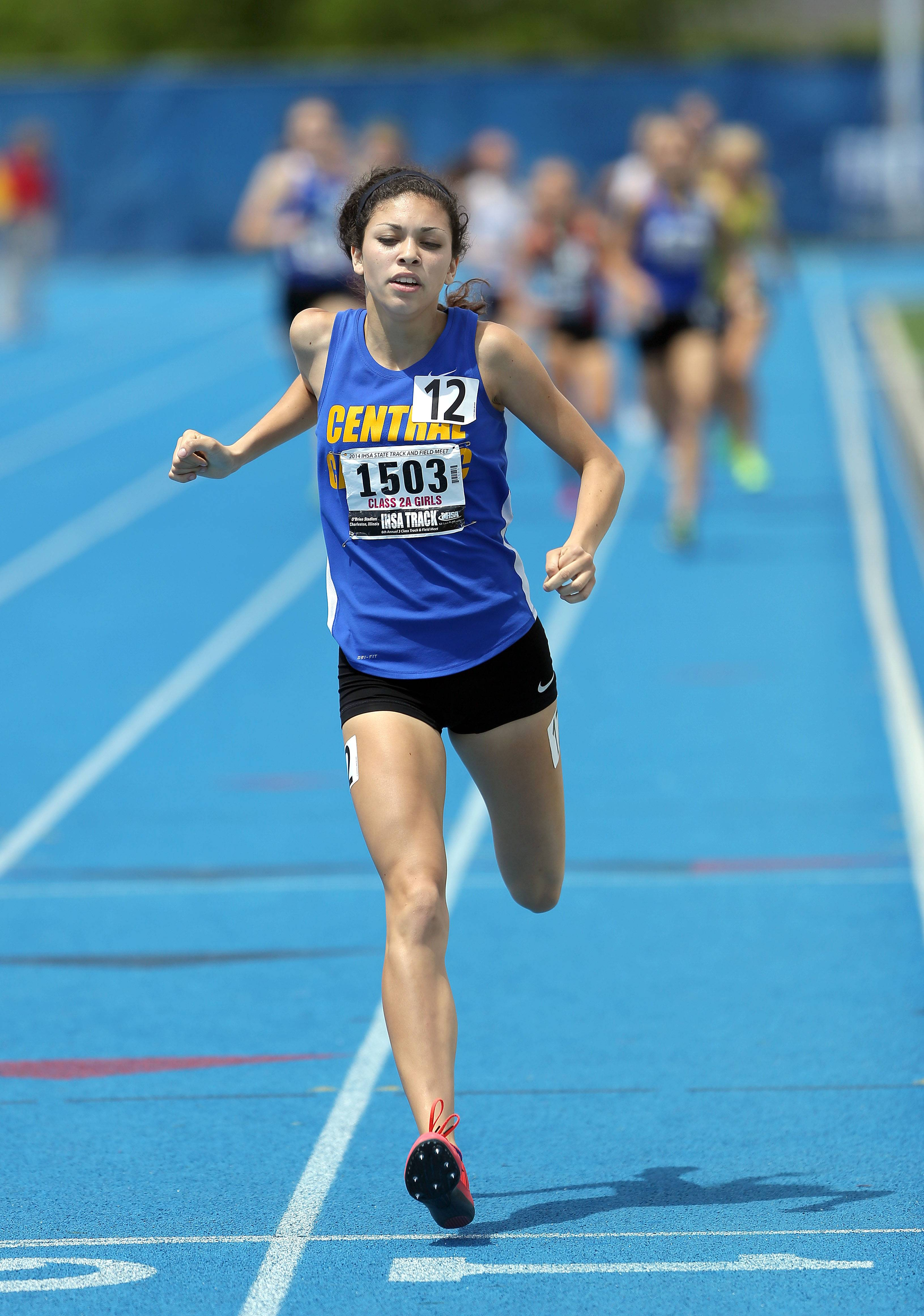 Aurora Central Catholic's Karina Liz finishes well ahead of the pack as she wins the class 2A 800-meter run during the girls track and field state finals at Eastern Illinois University in Charleston Saturday.