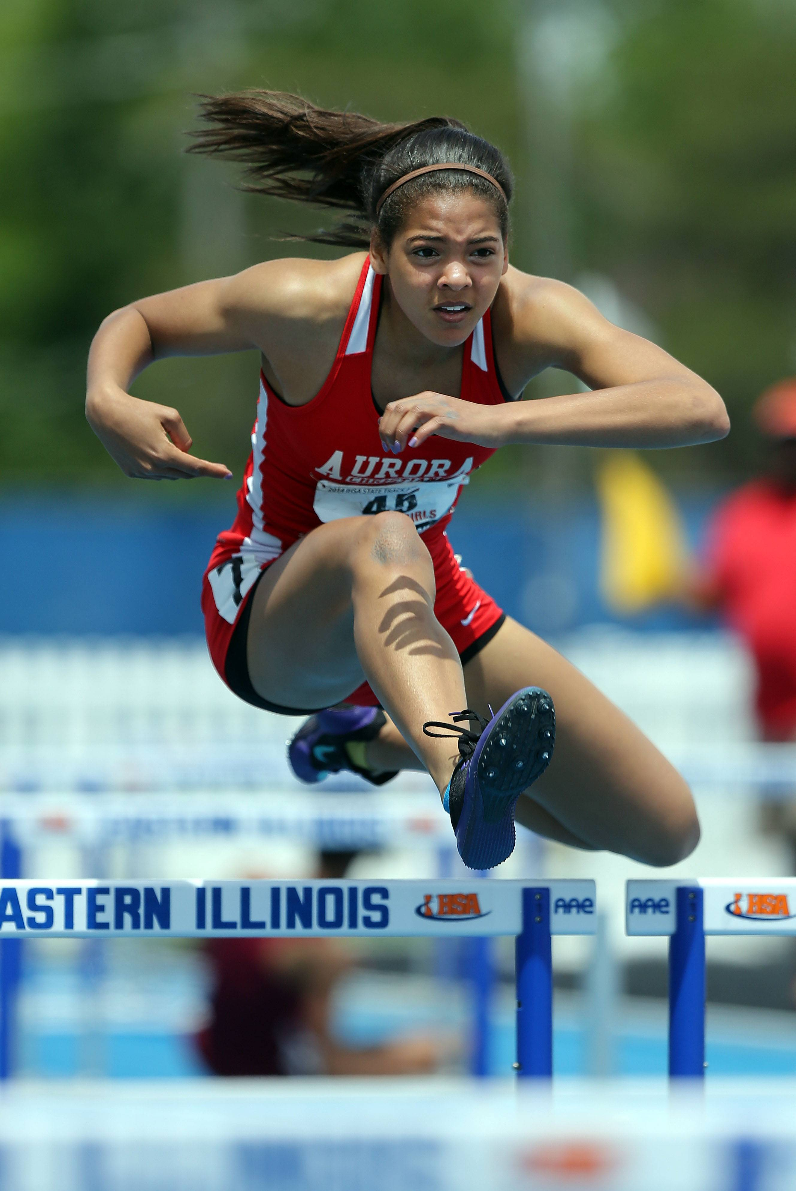 Aurora Christian's Peyton Wade competes in the 100-meter high hurdles during the girls track and field state finals at Eastern Illinois University in Charleston Saturday.