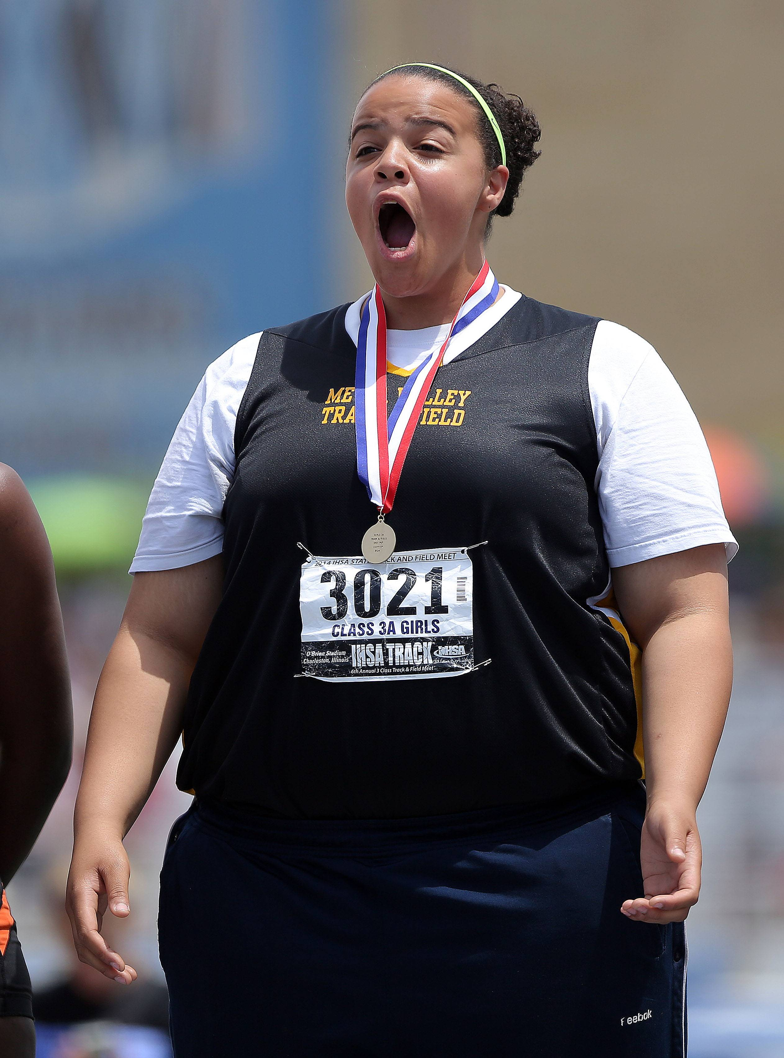 Metea Valley's Courtney Morgan reacts after getting her 1st place medal for the class 3A shot put during the girls track and field state finals at Eastern Illinois University in Charleston Saturday.
