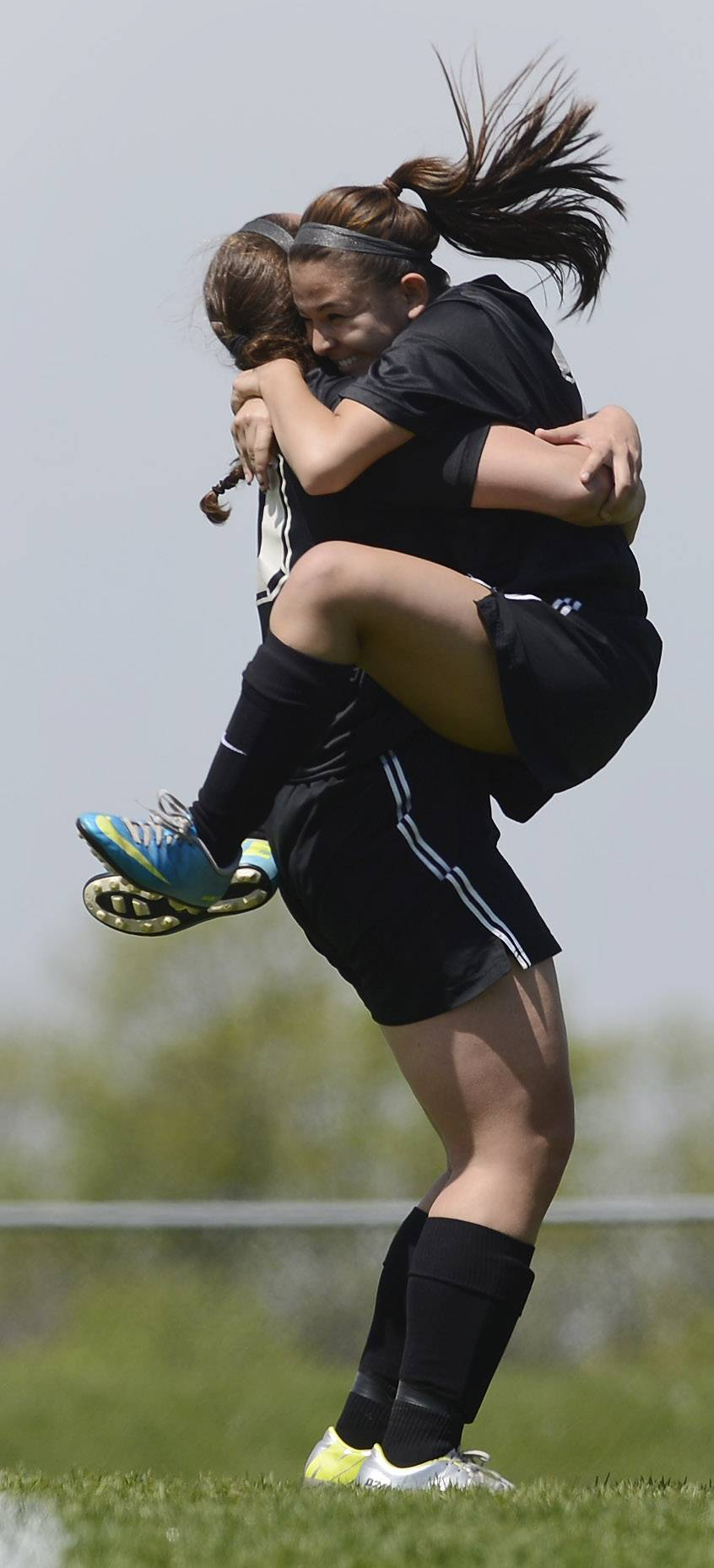 Larissa Dooley of Prairie Ridge, right, jumps into the arms of teammate Erin Ginsberg after scoring her team's third goal of the first half during the Class 2A regional final at Lakes on Saturday.