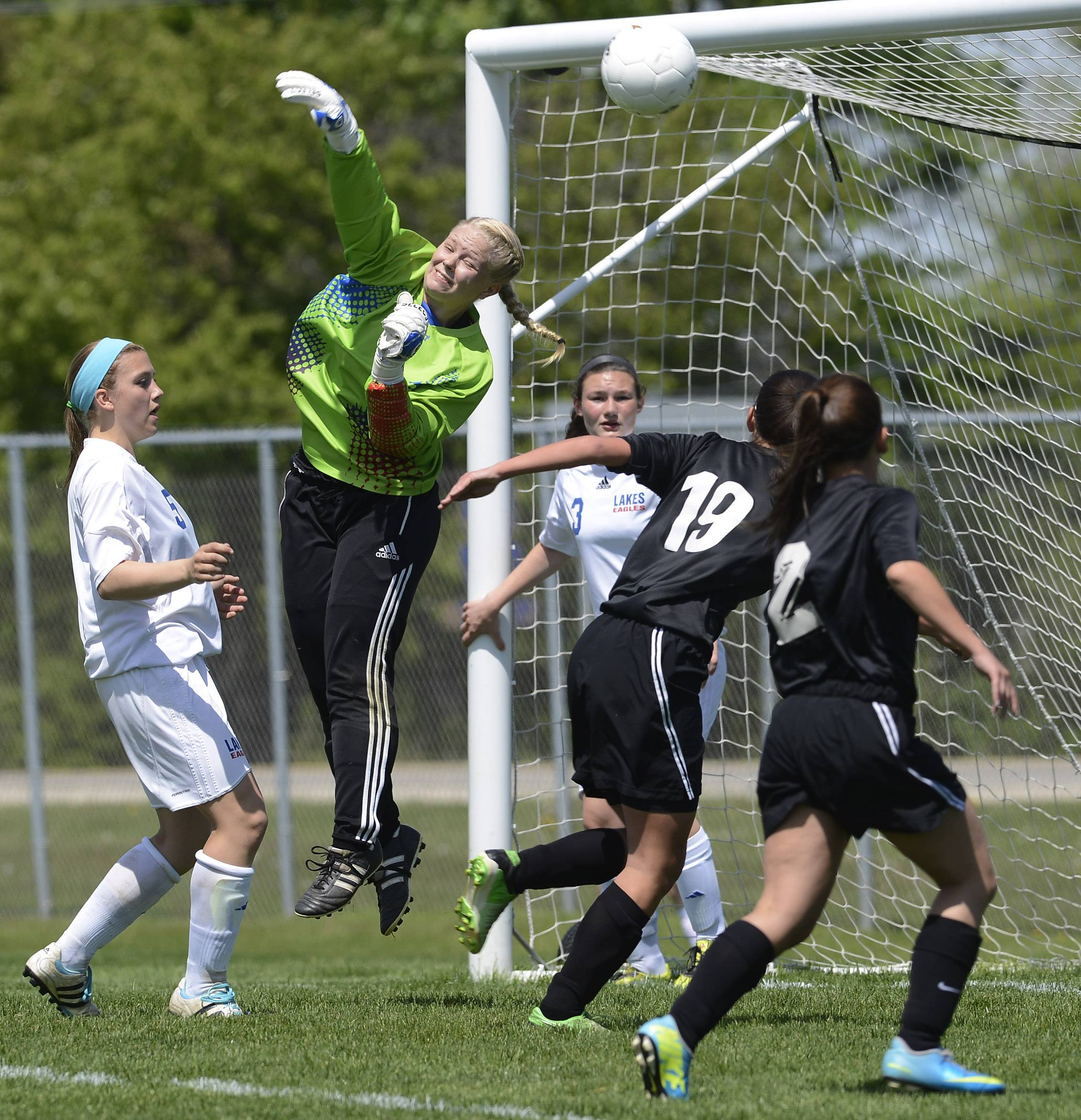 The ball sails over the outstretched hand of Lakes goalkeeper Kara Jones for a Prairie Ridge goal during the first half of the Class 2A regional final at Lakes on Saturday.