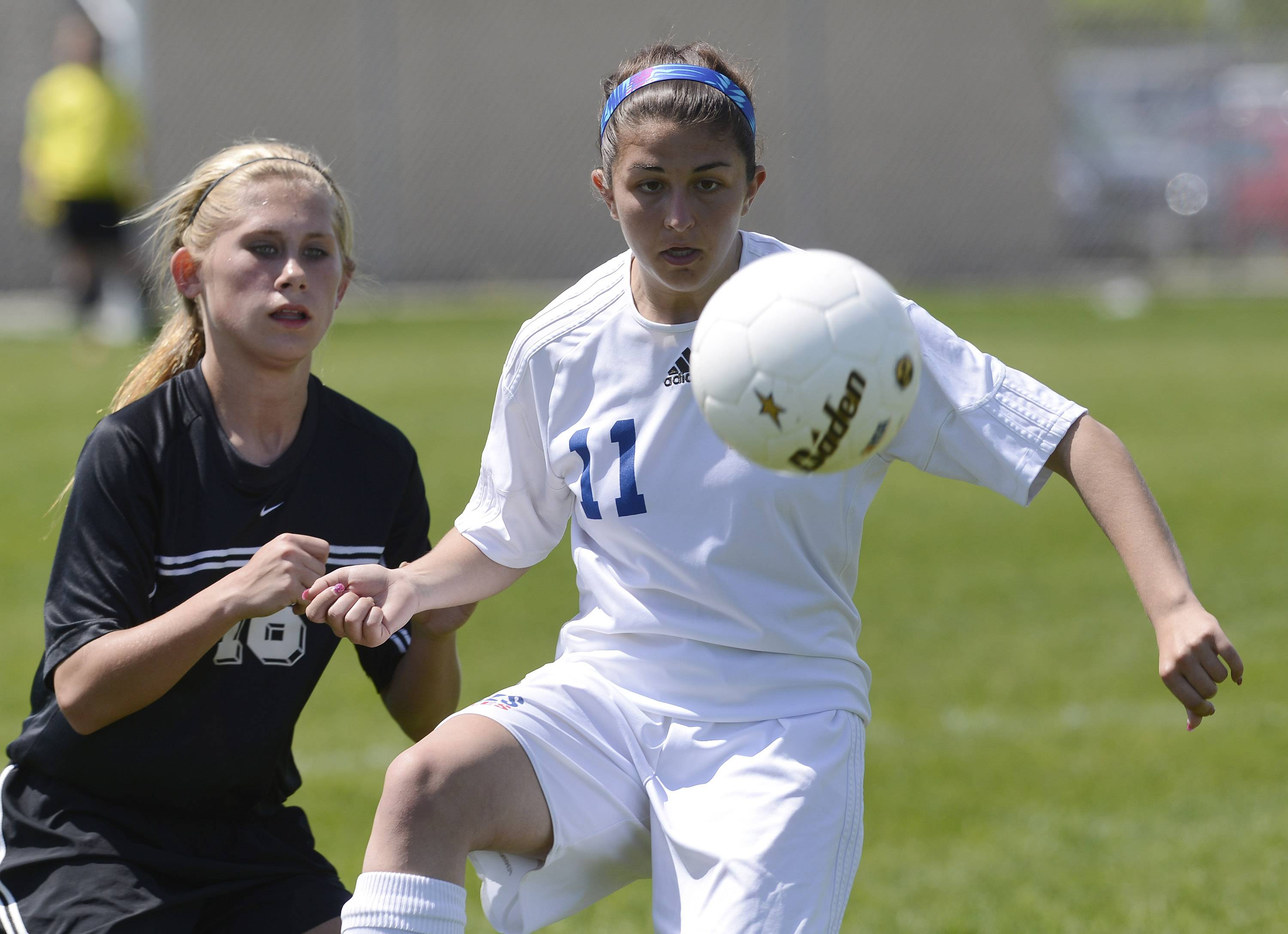 Nicole D'Ambrose of Lakes, right, tries to control the ball in front of Gabbi Fanning of Prairie Ridge during the Class 2A regional final at Lakes on Saturday.