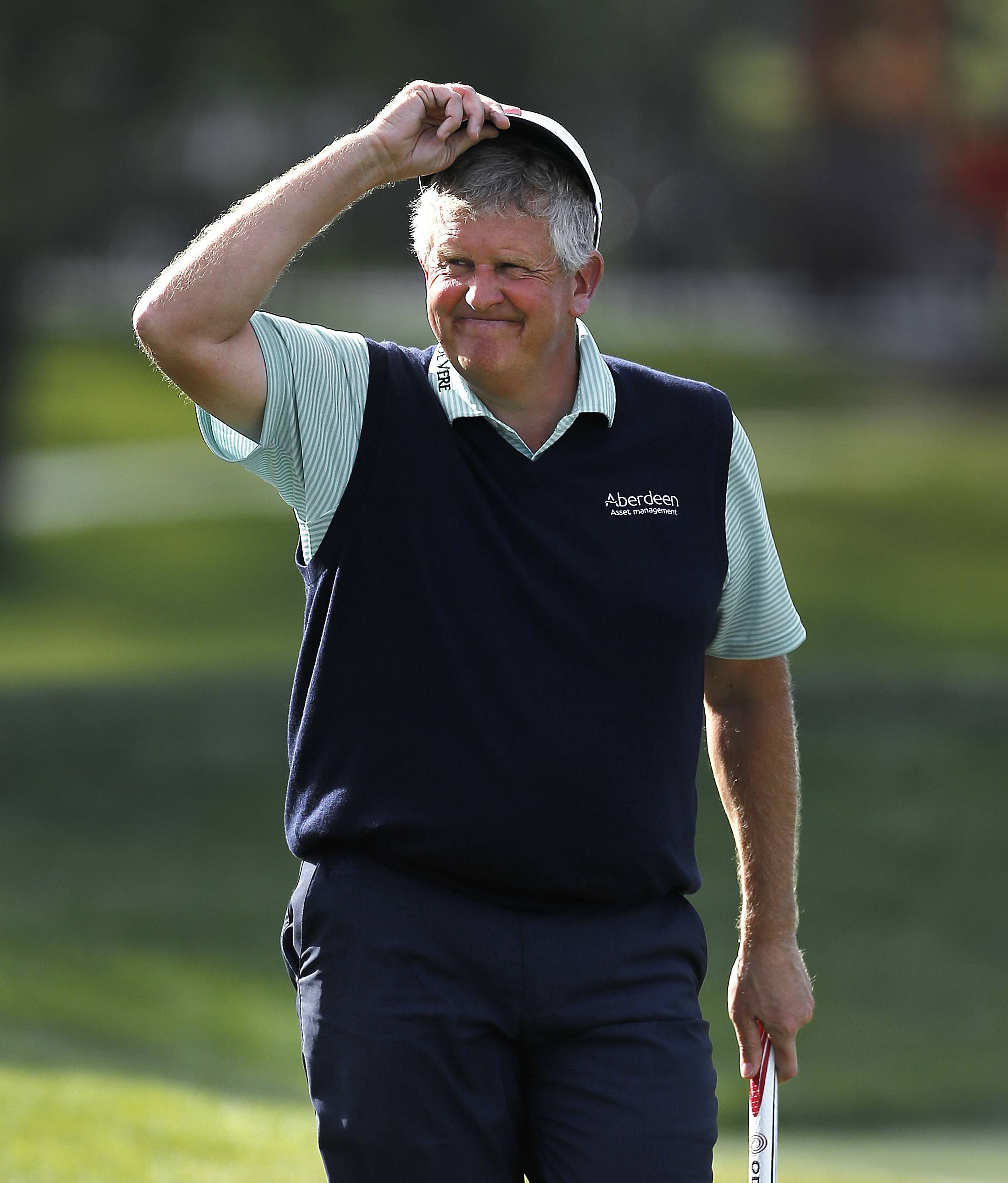 Scotland's Colin Montgomerie, who is a member of the World Golf Hall of Fame, has never won a tournament in the United States. But he holds a 1-shot lead over Bernhard Langer heading into today's final round of the Champions Tour's PGA Championship at Harbor Shores, Mich.