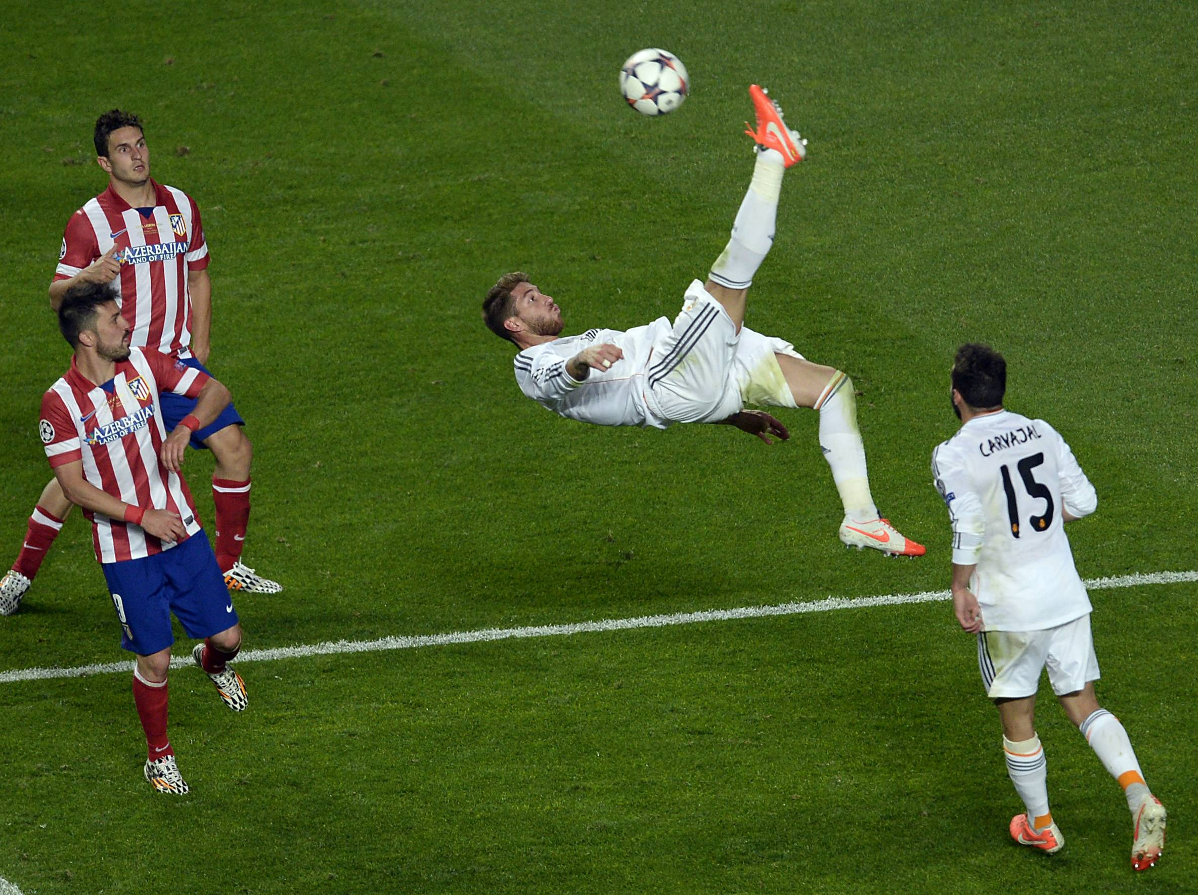 Real's Sergio Ramos kicks the ball during the Champions League final soccer match between Atletico Madrid and Real Madrid in Lisbon, Portugal, Saturday, May 24, 2014.