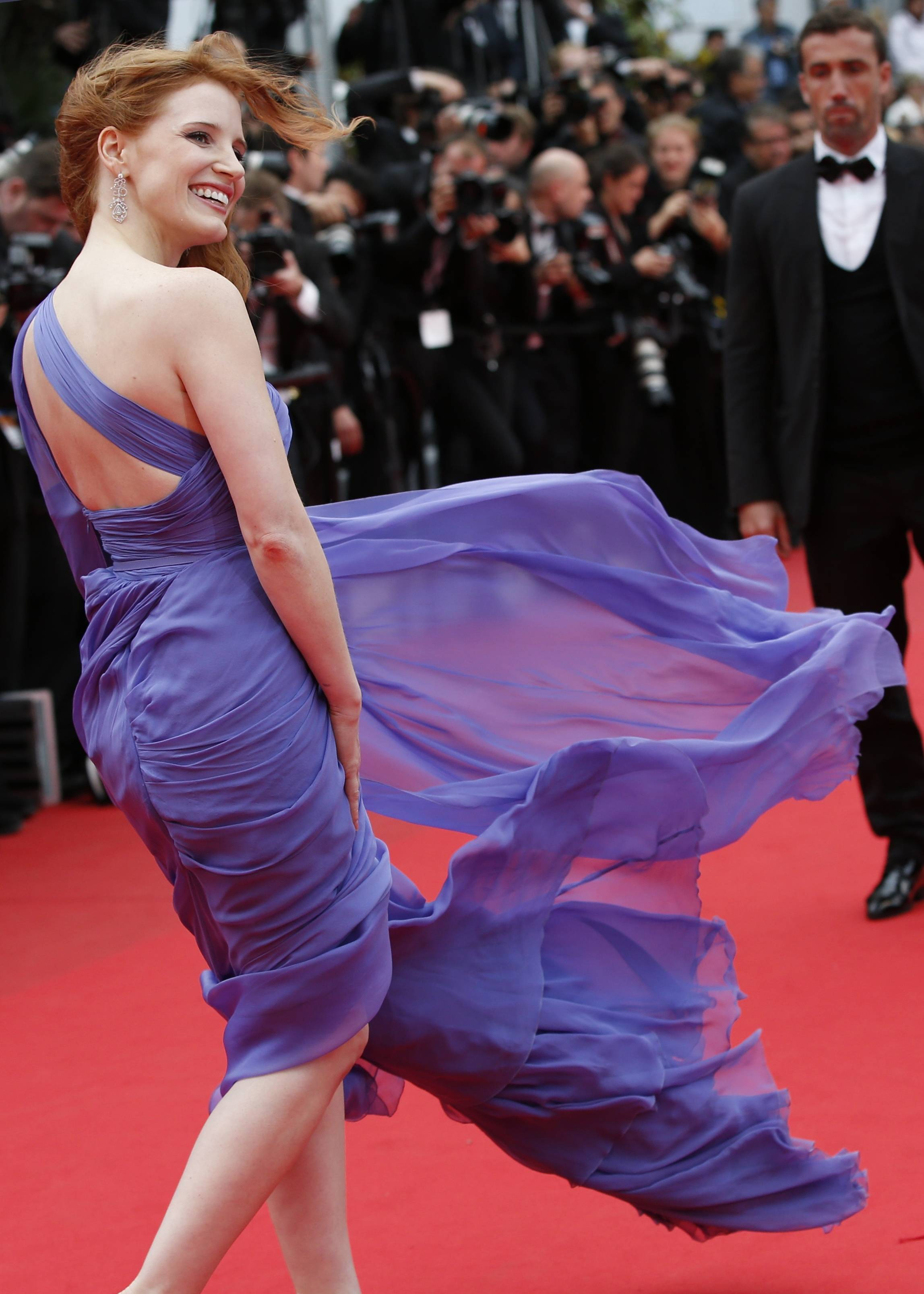 "Actress Jessica Chastain poses for photographers as she arrives for the May 19 screening of ""Foxcatcher"" at the 67th annual Cannes Film Festival in southern France."