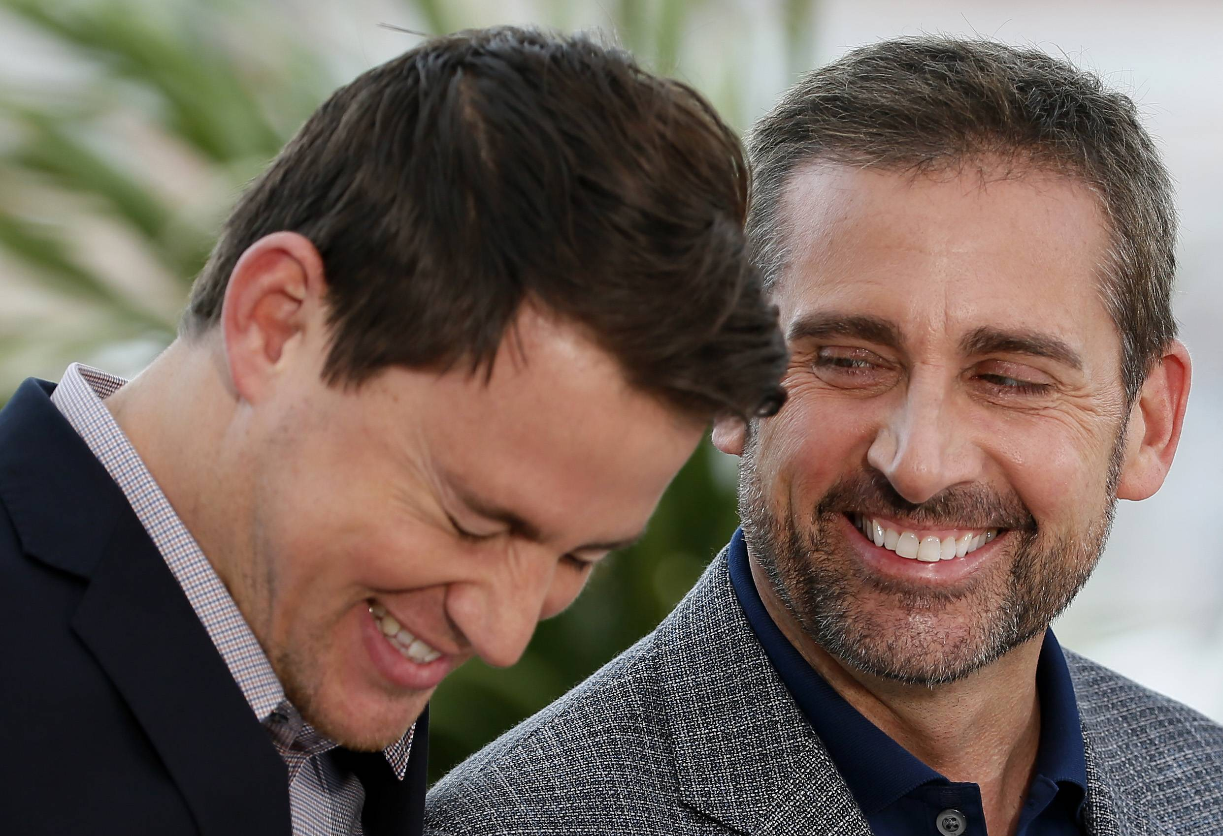 "Actors Steve Carell, right, and actor Channing Tatum laugh during a Monday, May 19, photo call for ""Foxcatcher"" at the 67th Cannes Film Festival in southern France."