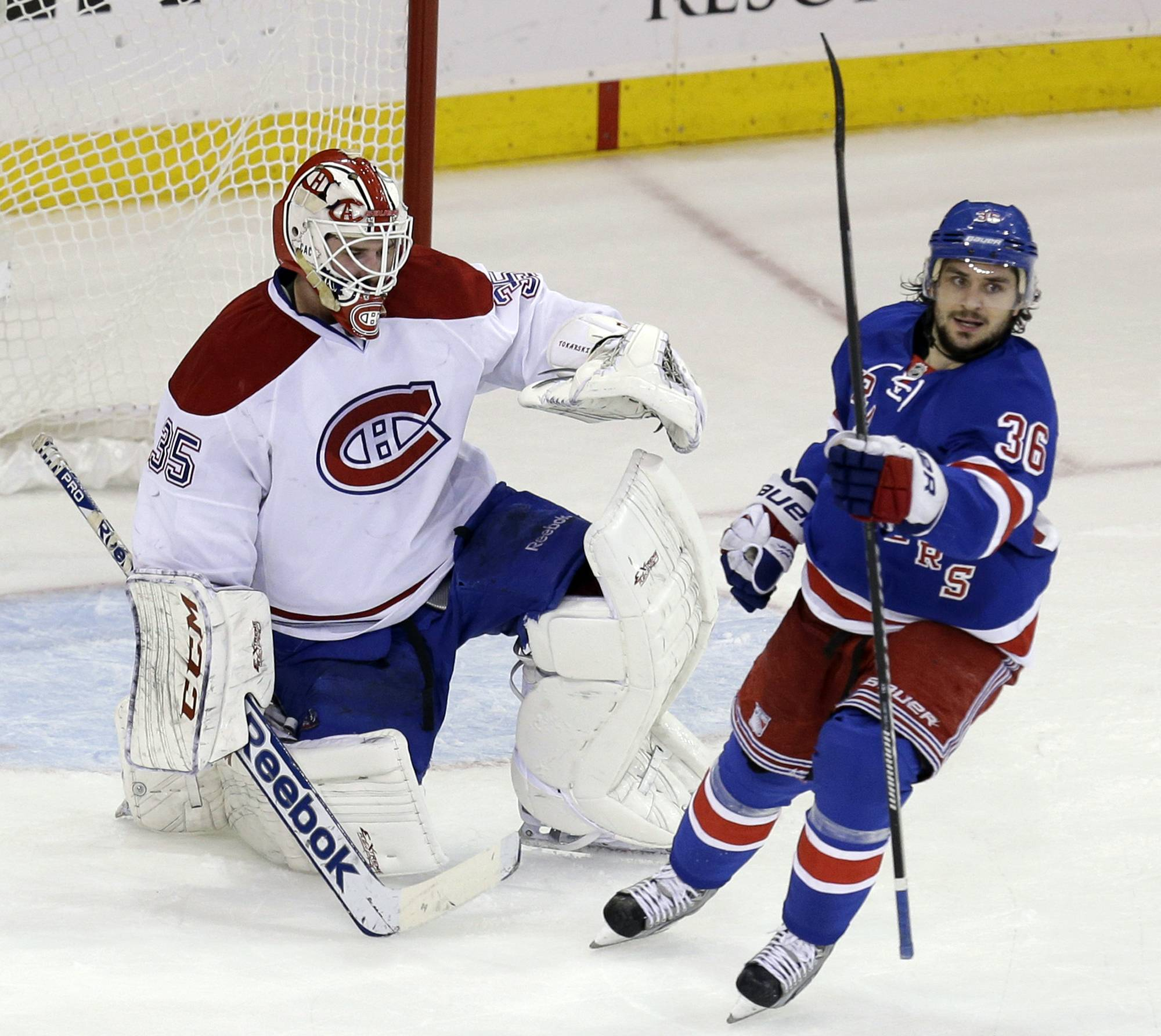 Montreal Canadiens goalie Dustin Tokarski, left, and New York Rangers' Mats Zuccarello react after New York Rangers' Derick Brassard scored during the second period of Game 4 of the NHL hockey Stanley Cup playoffs Eastern Conference finals, Sunday, May 25, 2014, in New York.
