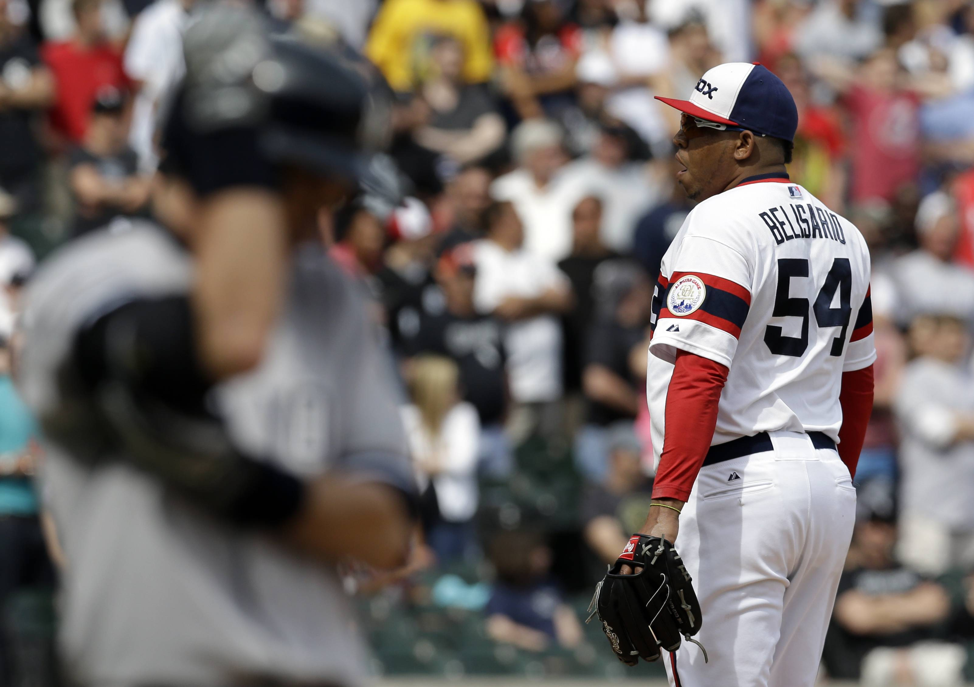 White Sox closer Ronald Belisario reacts during Saturday's blown safe, when the Yankees scored 3 runs in the ninth inning and won in the 10th. Sox manager Robin Ventura said Sunday he is sticking with Belisario as his closer.