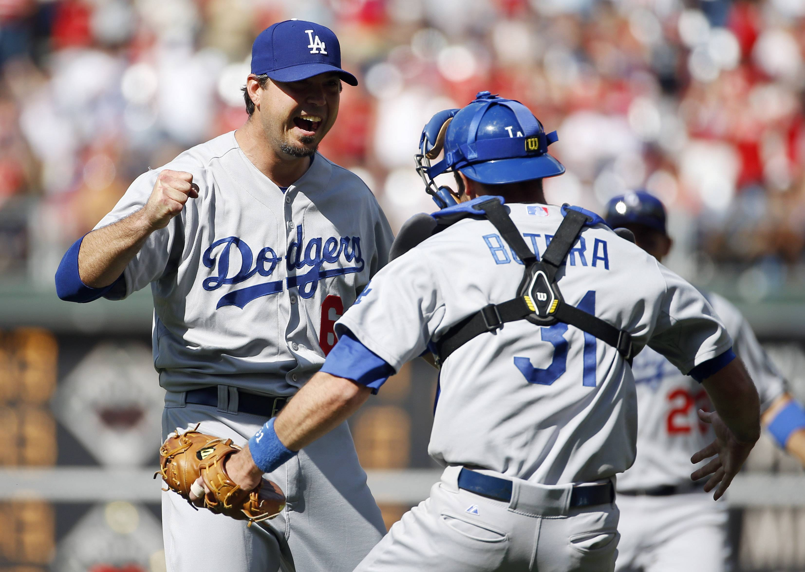 Los Angeles Dodgers starting pitcher Josh Beckett, left, celebrates with catcher Drew Butera after striking out Philadelphia Phillies' Chase Utley looking for a no-hitter baseball game, Sunday, May 25, 2014, in Philadelphia. Los Angeles won 6-0.