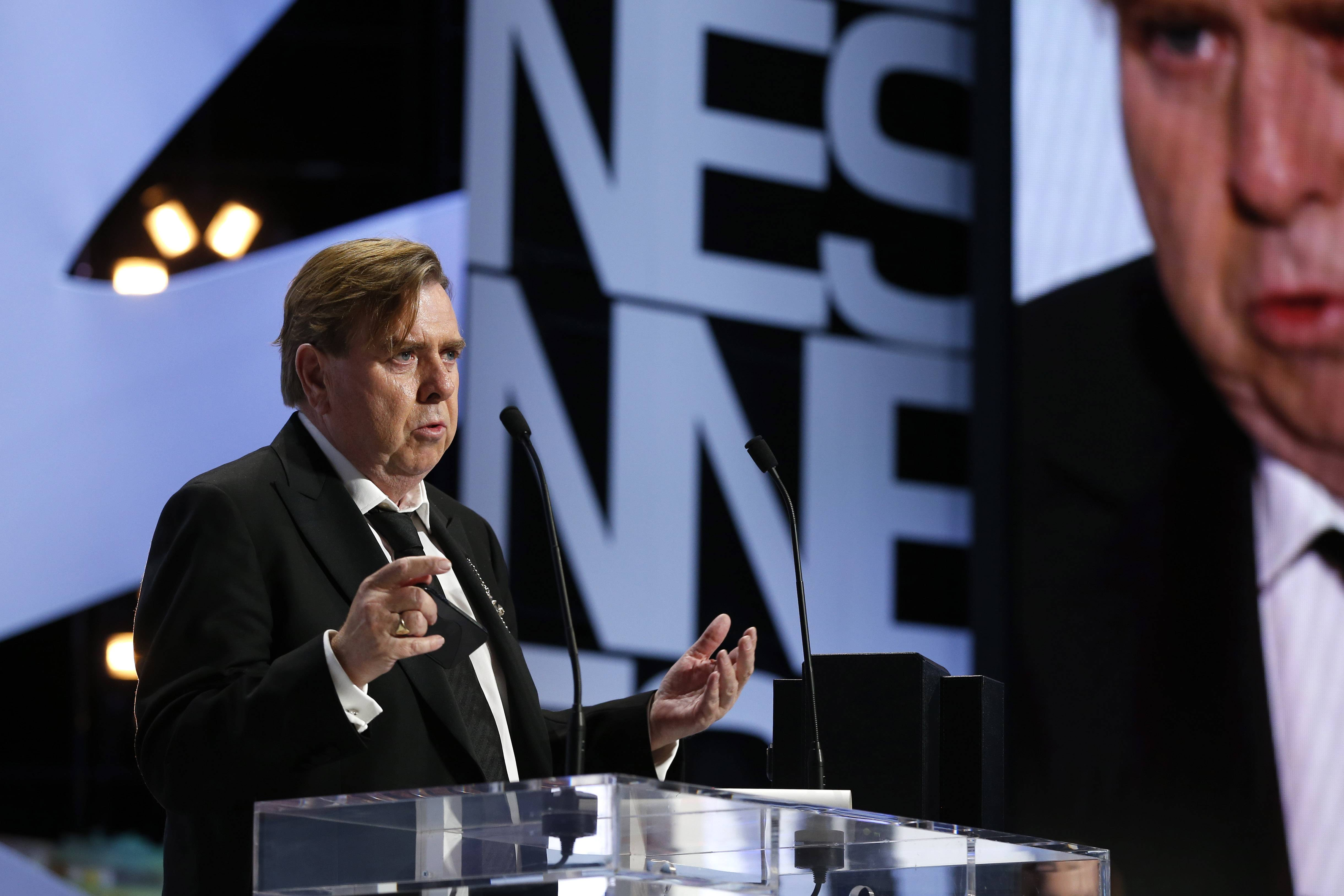 Timothy Spall delivers a speech after winning the Best Actor award for his role in the film Mr. Turner during the awards ceremony Saturday for the 67th annual Cannes Film Festival in southern France.