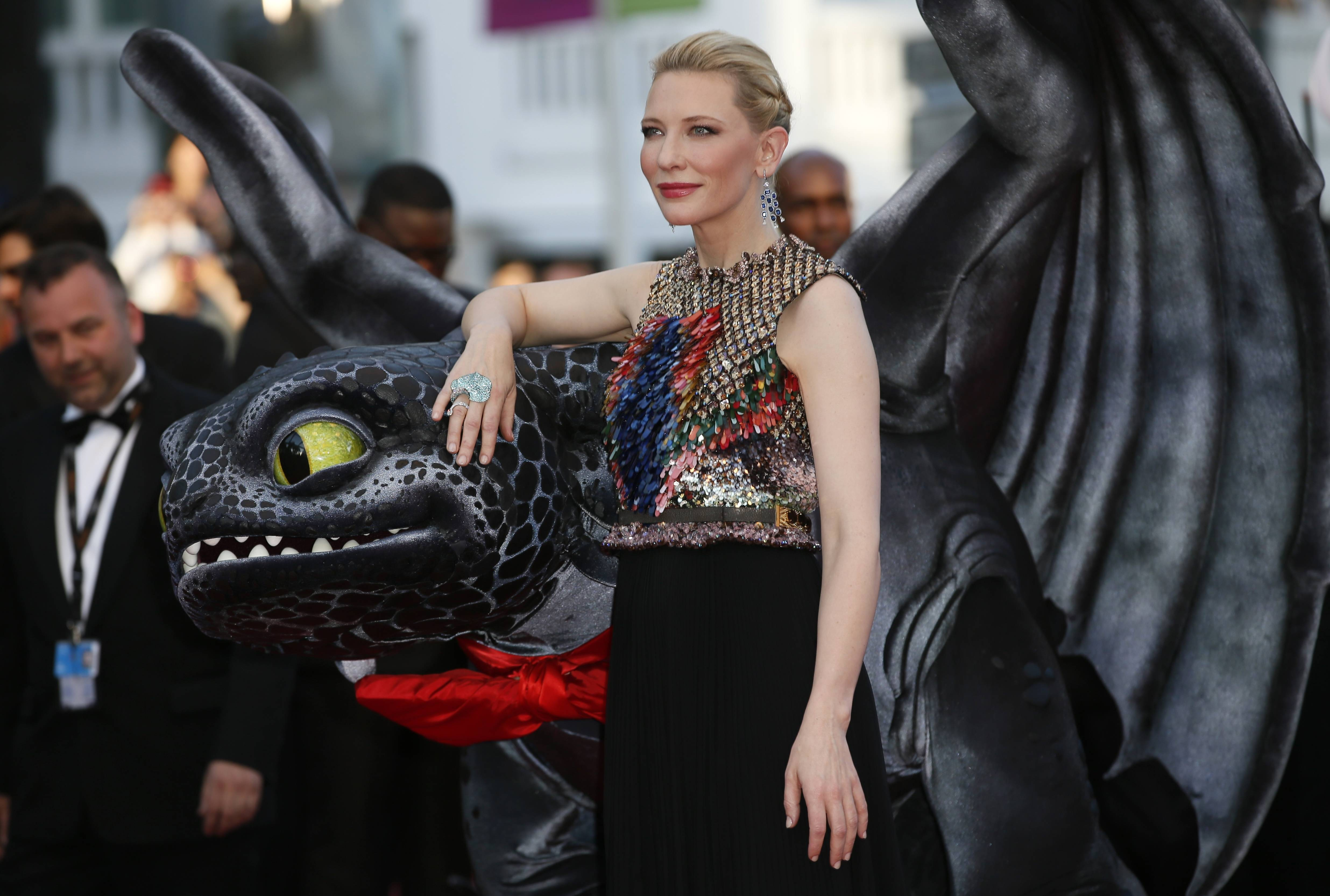 "Actress Cate Blanchett touches a giant puppet of the dragon named Toothless during arrivals for May 16 the screening of ""How to Train Your Dragon 2"" at the 67th annual Cannes Film Festival in southern France."