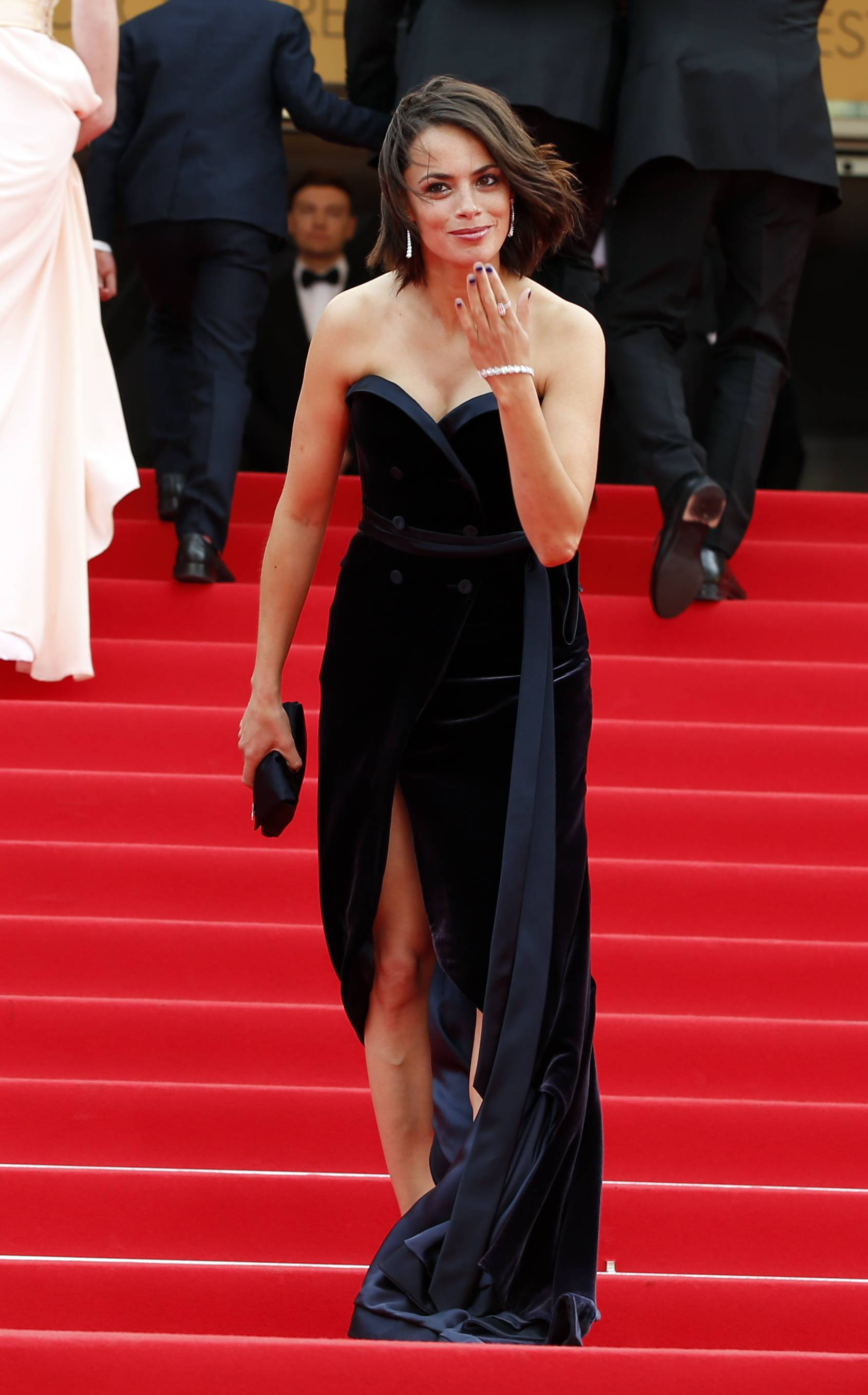 "Actress Berenice Bejo blows a kiss as she arrives for the May 21 screening of ""The Search"" at the 67th annual Cannes Film Festival in southern France."
