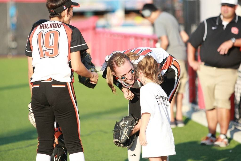 Kids get to interact with players at Chicago Bandits professional softball games in Rosemont.