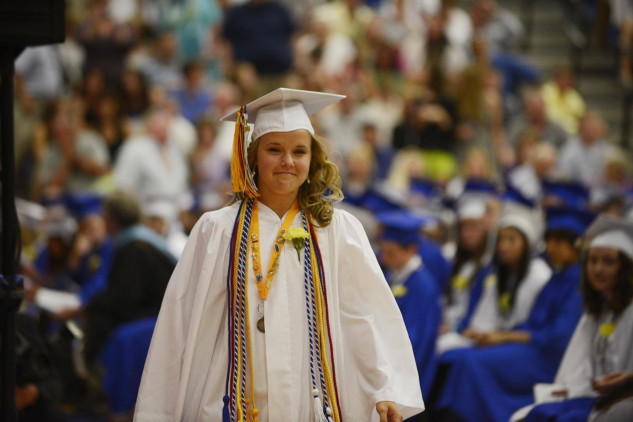 President of the Class of 2014, Hallie McQueeny, approaches the podium to present the graduates at the Geneva High School 2014 commencement exercises Sunday.
