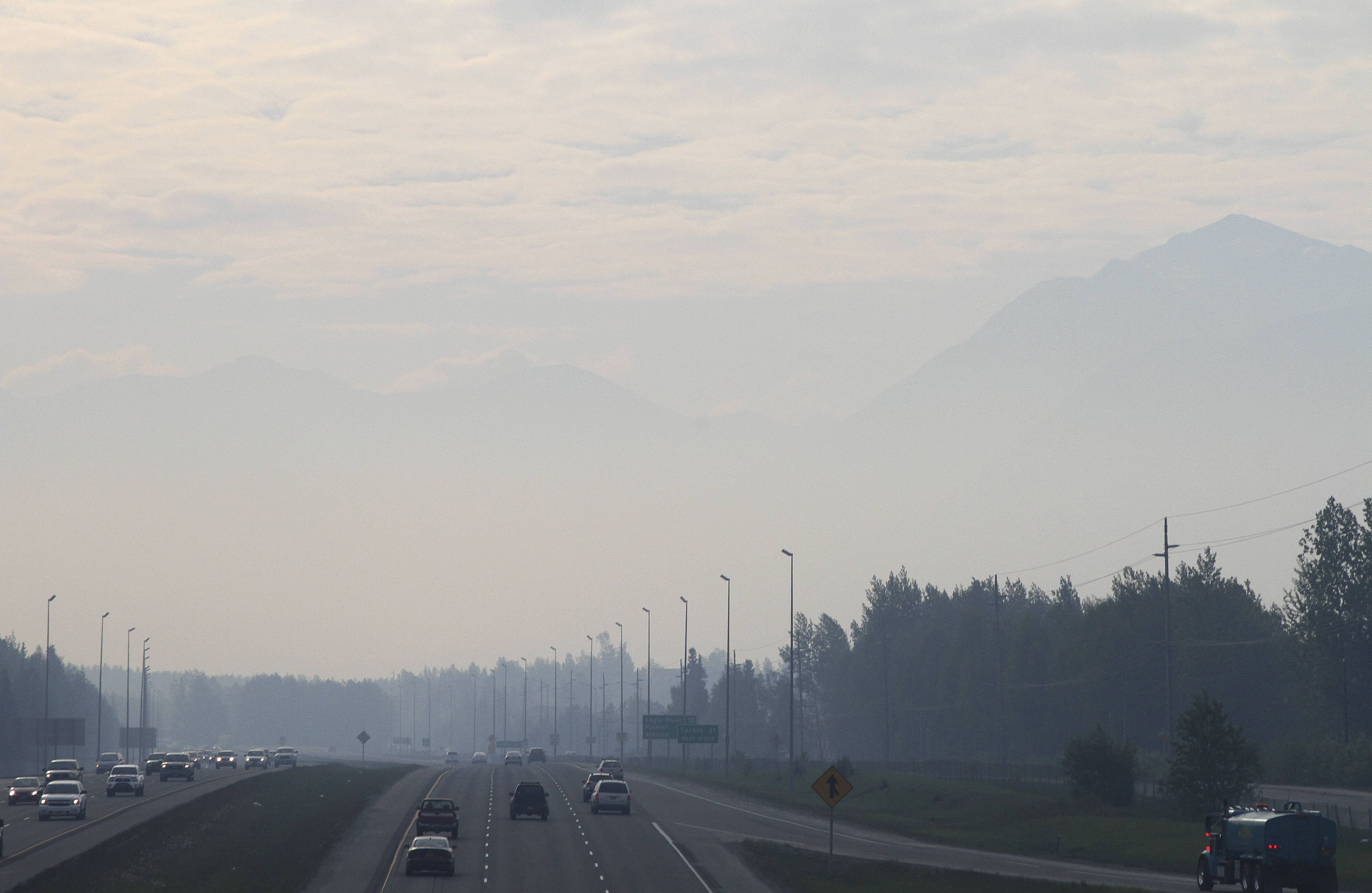 Haze from smoke covers a highway in Anchorage, Alaska, Thursday. Residents in Anchorage woke up Thursday to a smokey haze and the smell of a campfire over the state's largest city. The smoke is from wildfires burning on Alaska's Kenai Peninsula.