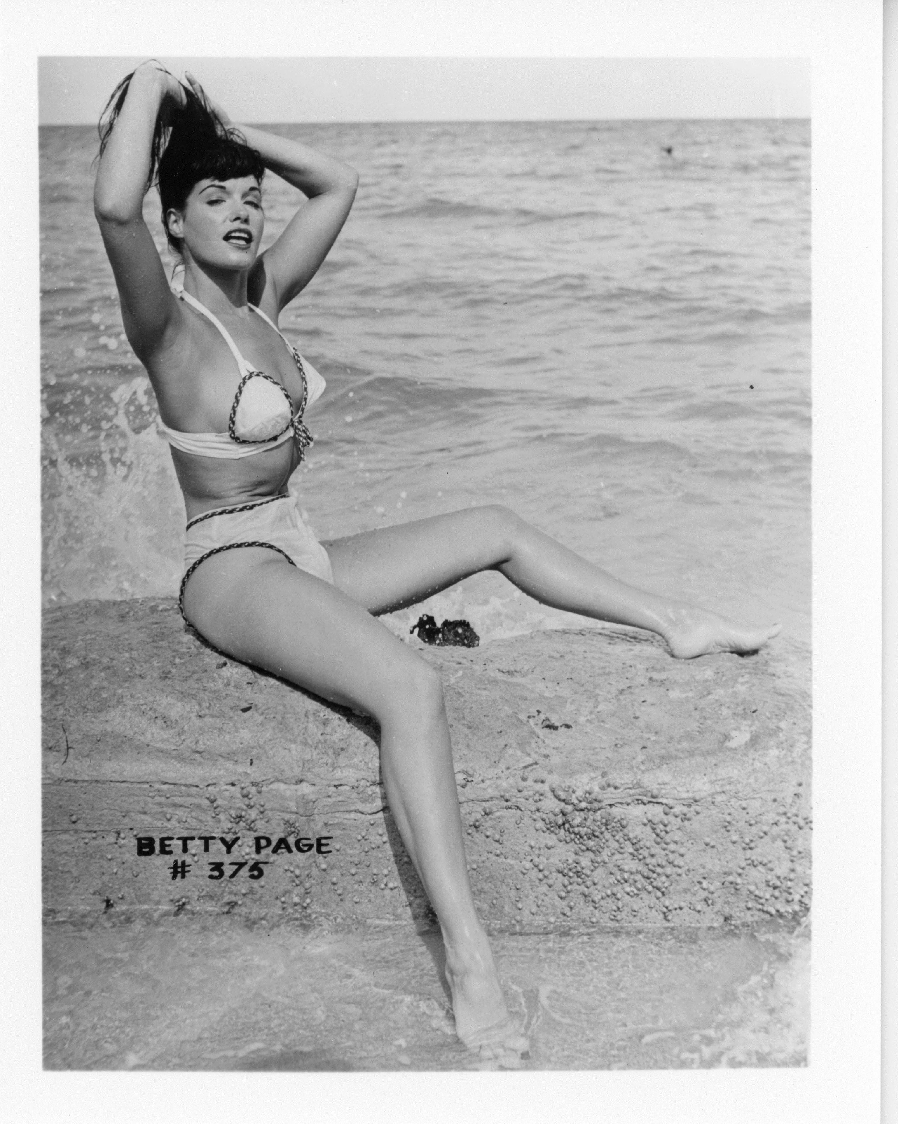 Bunny Yeager's photos of Bettie Page in a leopard-print bathing suit standing next to a real cheetah helped launch a pin-up career for Yeager as a photographer and Page as a beauty.