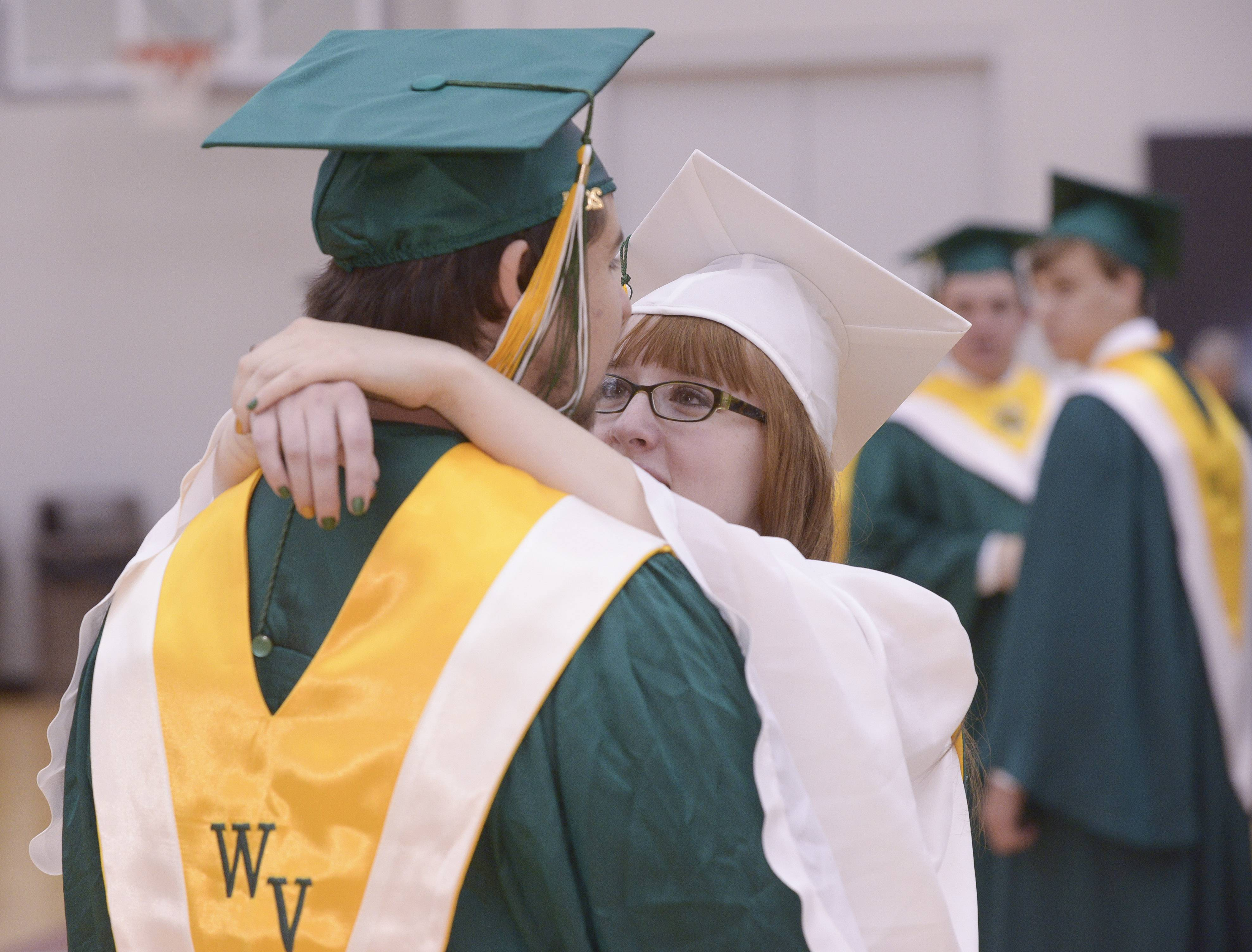 Daniel Medrano and Kami Baab share a moment before the start of the Waubonsie Valley High School graduation on Sunday, May 25 at NIU in DeKalb.