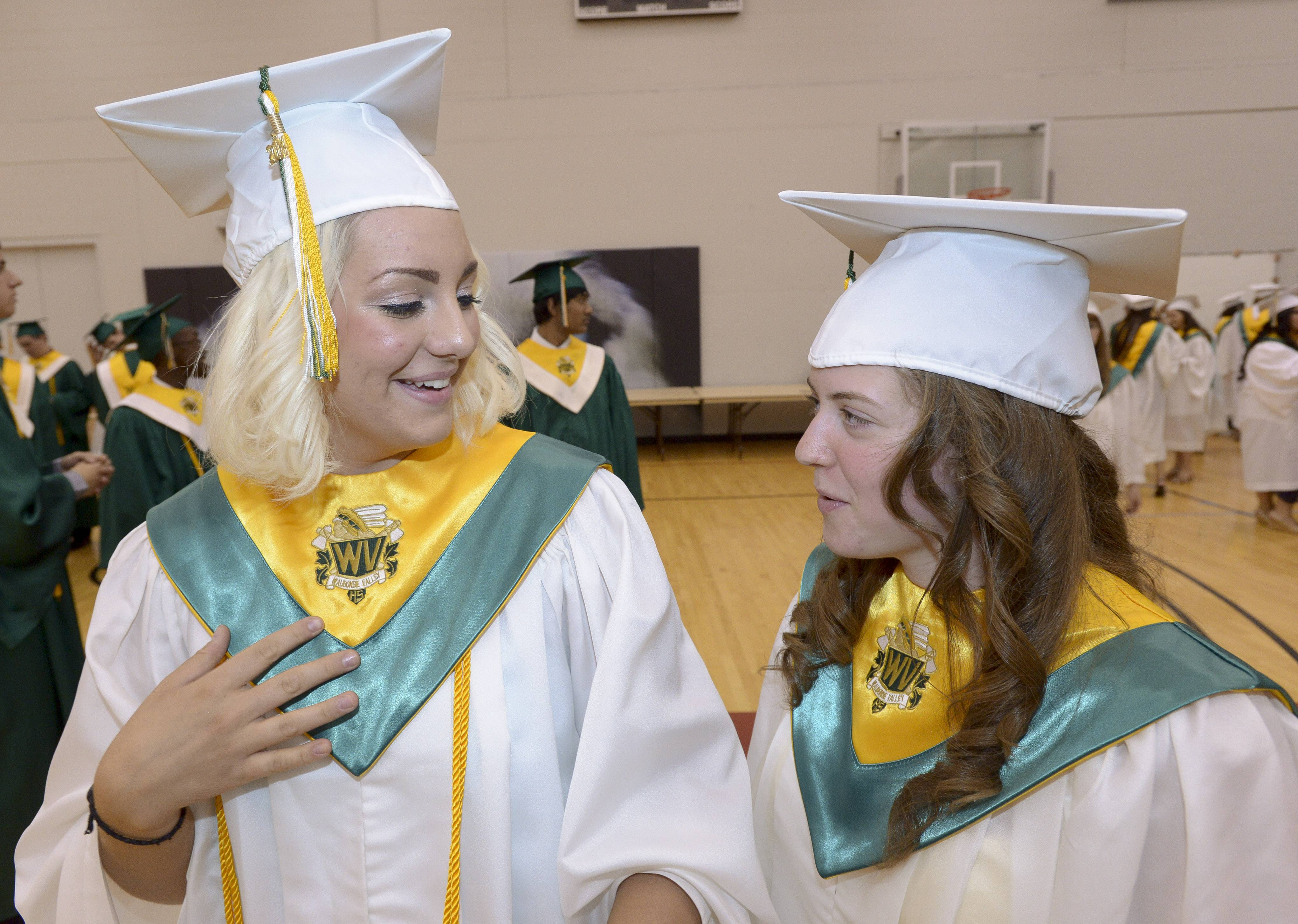 Monica Kunovszky and Christine Clutter get ready for the Waubonsie Valley High School graduation at NIU in DeKalb.