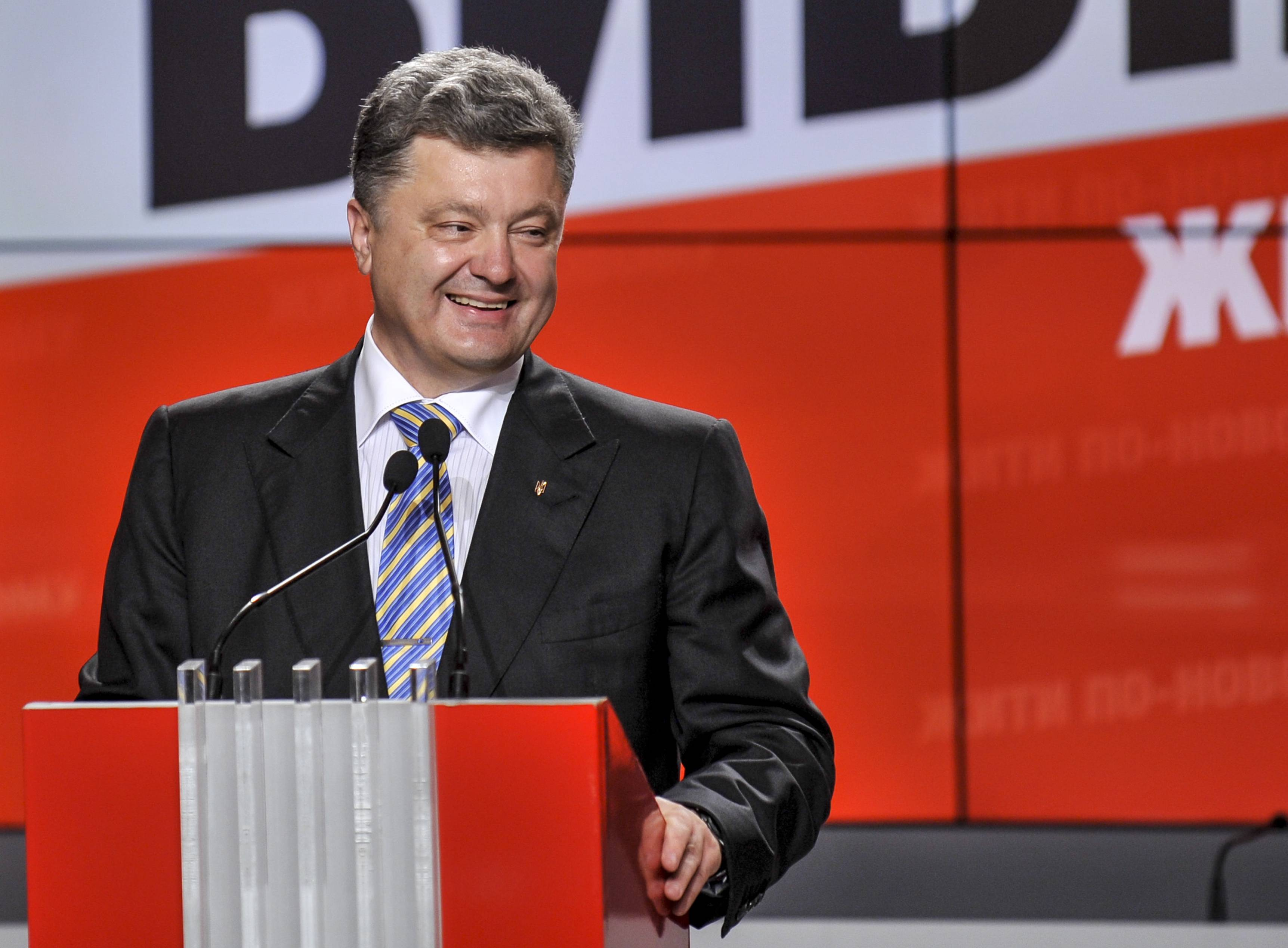 Apparent winning Ukrainian presidential candidate Petro Poroshenko smiles during his news conference in Kiev, Ukraine, Sunday.