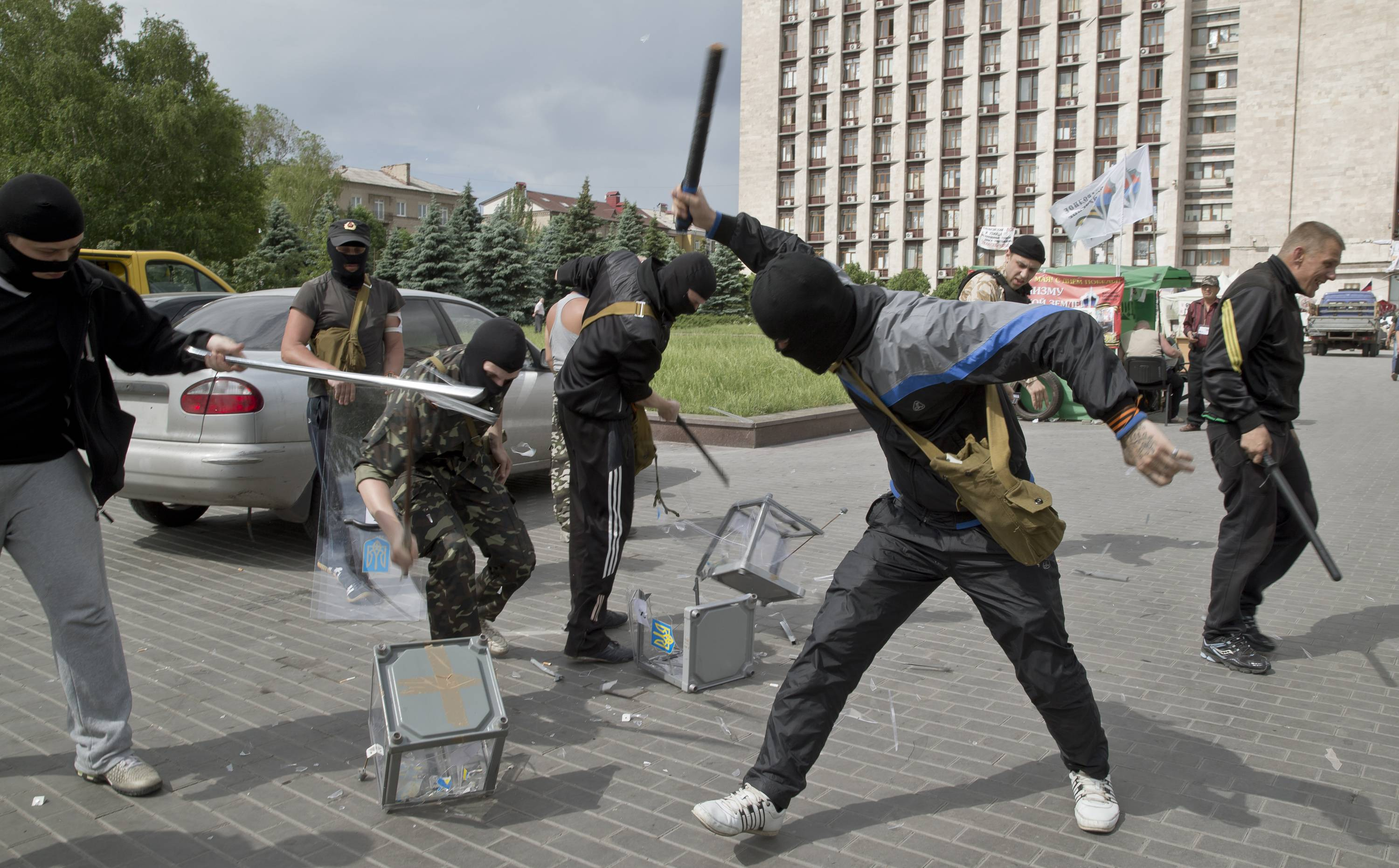 Pro-Russian militants smash ballot boxes in front of the seized regional administration building in Donetsk, Ukraine, Sunday.