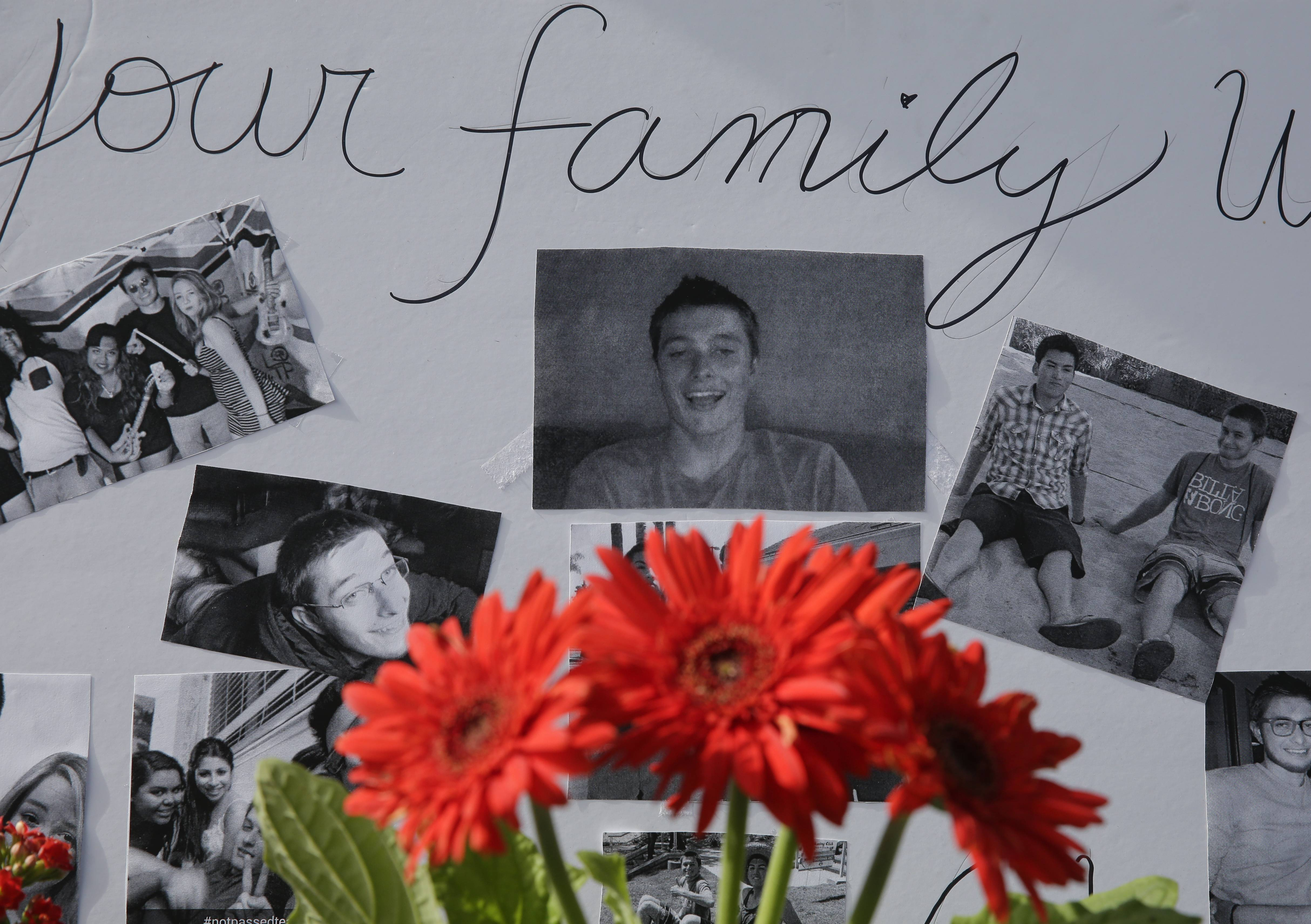 Images of Christopher Martinez are displayed as part of a memorial in front of the IV Deli Mart, where part of Friday night's mass shooting took place, on Sunday.