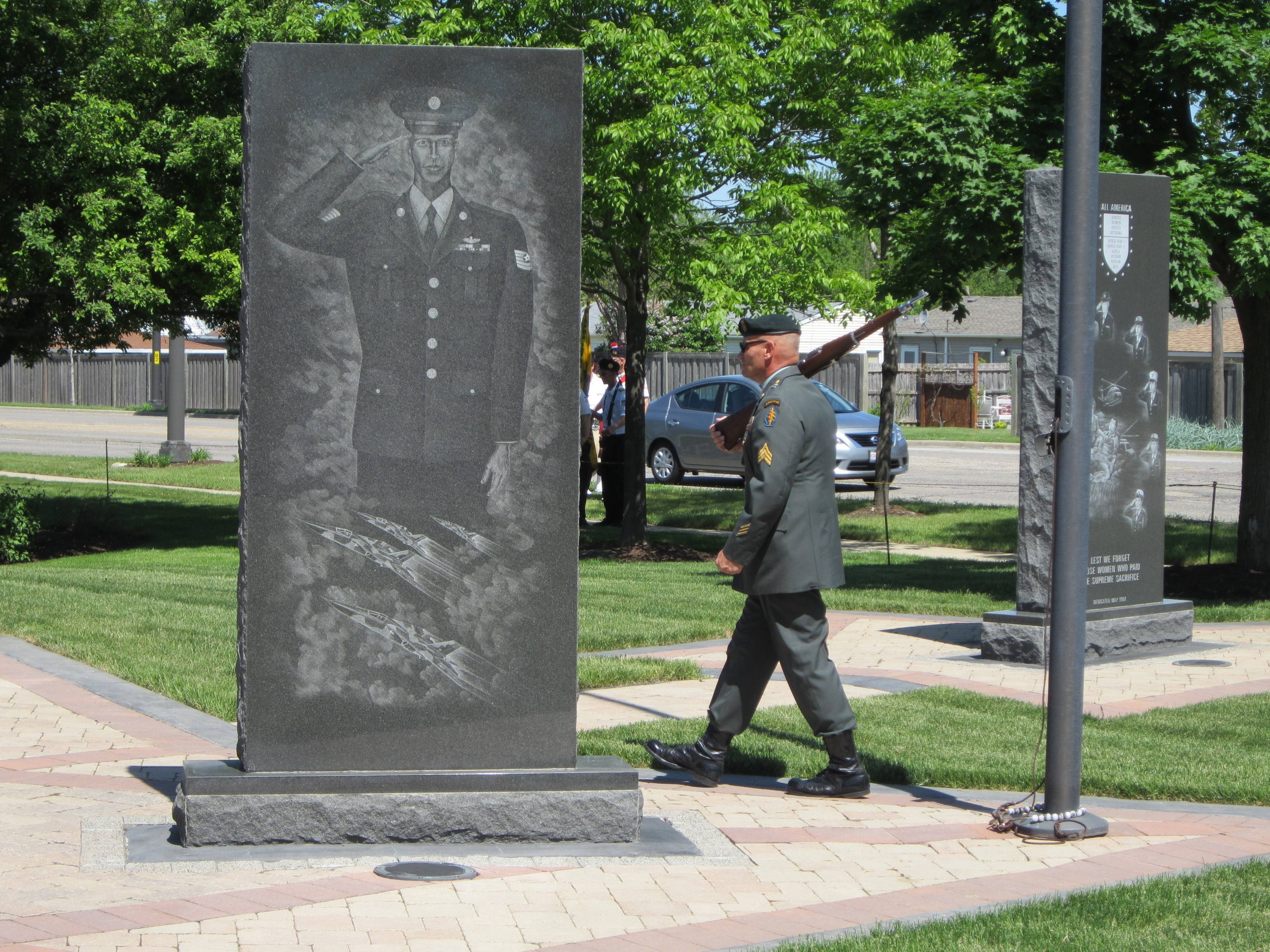 A solitary vigil guard marches through Streamwood's Veterans Memorial prior to Sunday's ceremony. The vigil guard began on Saturday evening and continued overnight.